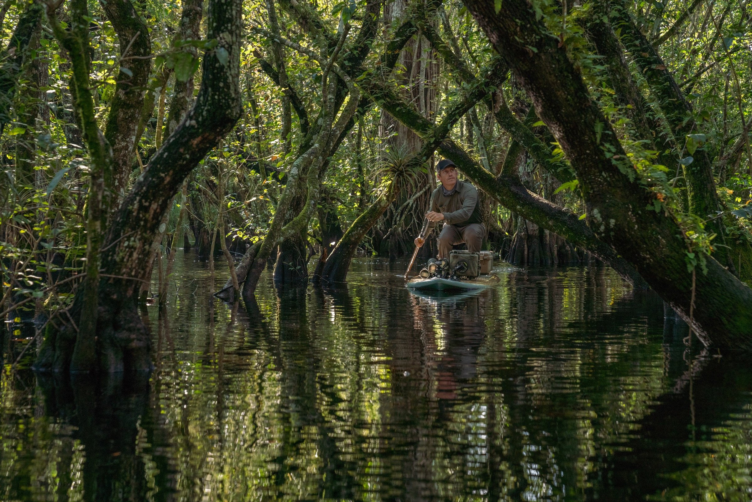 Carlton Ward Jr. paddles into a remote corner of the Fakahatchee Strand to set up a camera-trap system. Self-portrait by Carlton Ward Jr.
