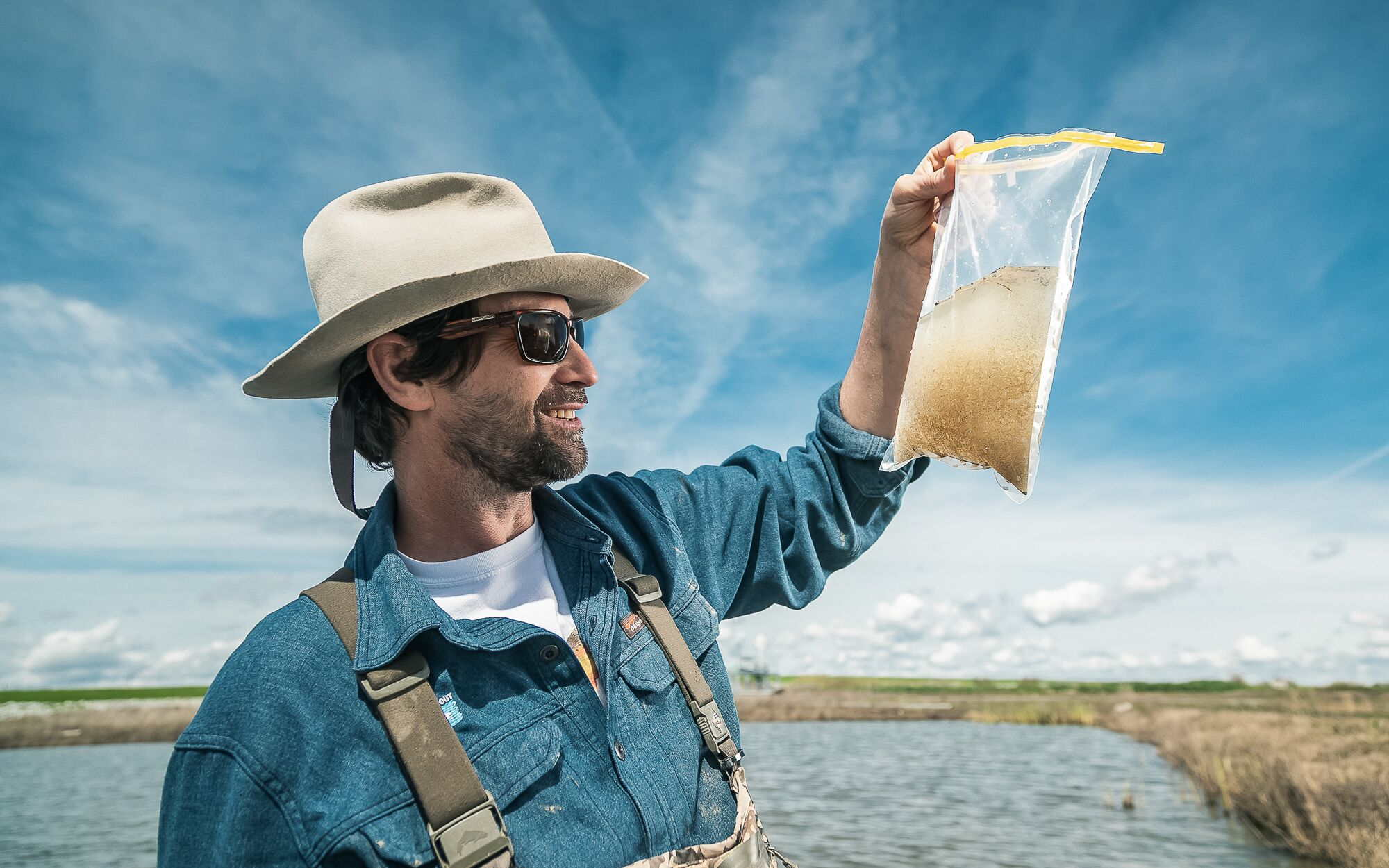 Jacob Katz examines a water sample full of zooplankton, pulled from a flooded rice field at Knaggs Ranch near the Sacramento River.