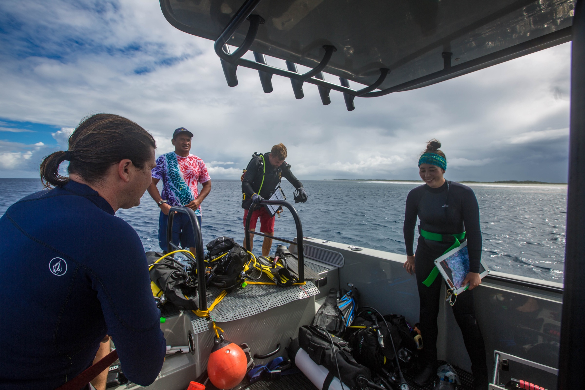 Stuart Sandin, Teina Rongo, Hank Lynch, and Nicole Pedersen prep for their next dive. Photograph by Shayna Brody