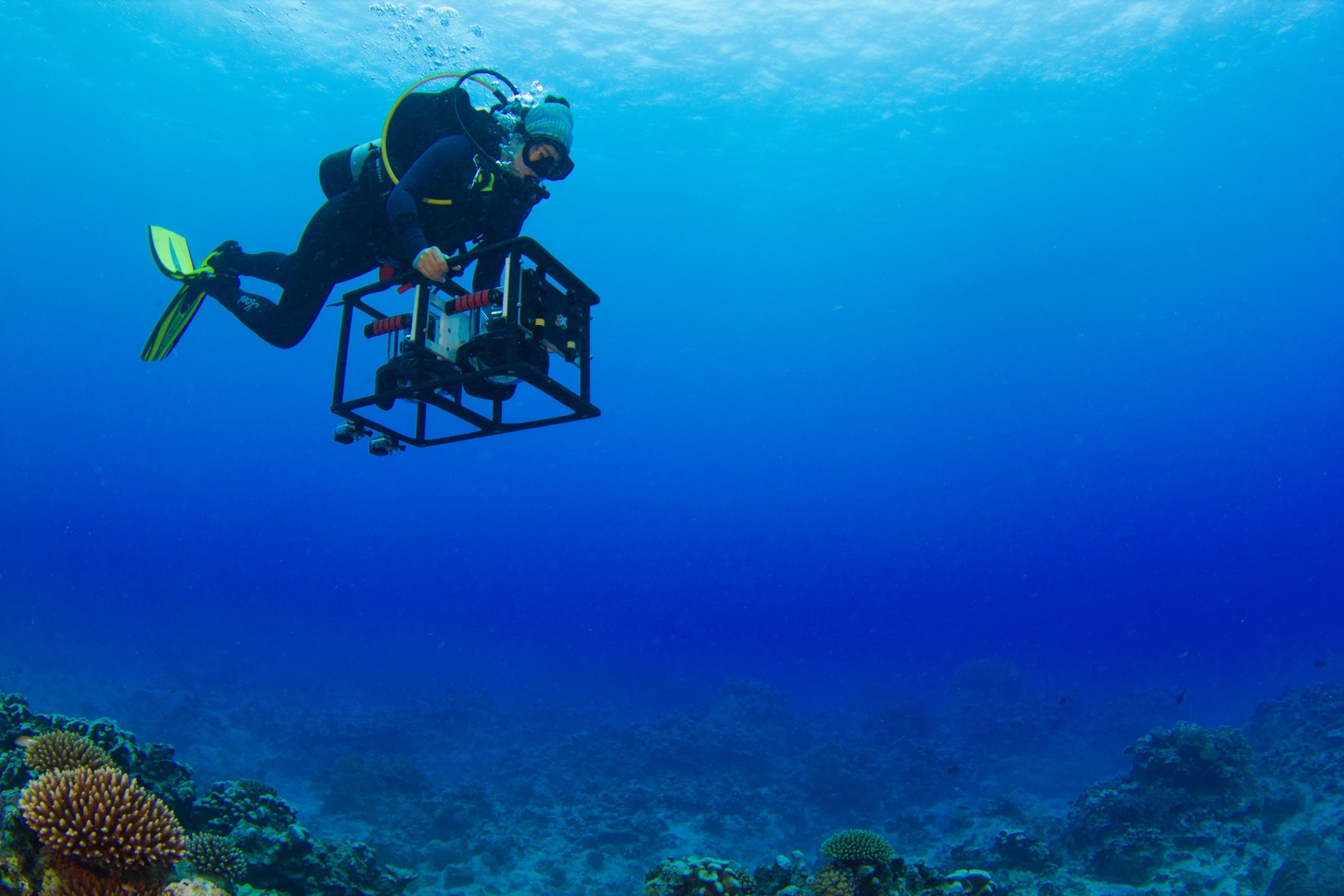 Nicole Pederson pilots the mosaic camera system taking images of the coral reef ecosystem off the coast of Rarotonga. Photograph by Brian Zgliczynski/100 Island Challenge