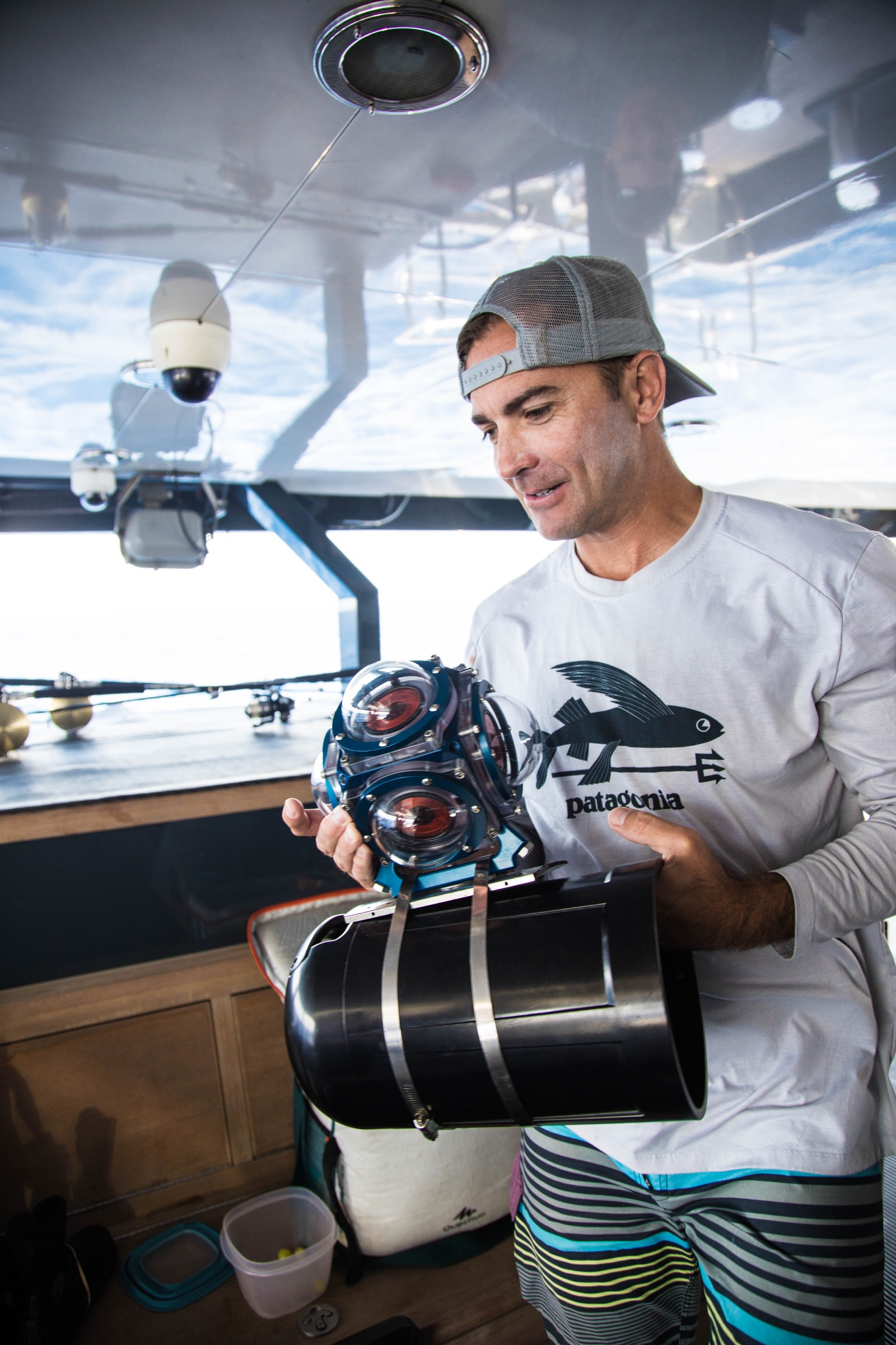 Brian Zgliczynski preps a 360-degree camera for the next dive. Photography by Shayna Brody