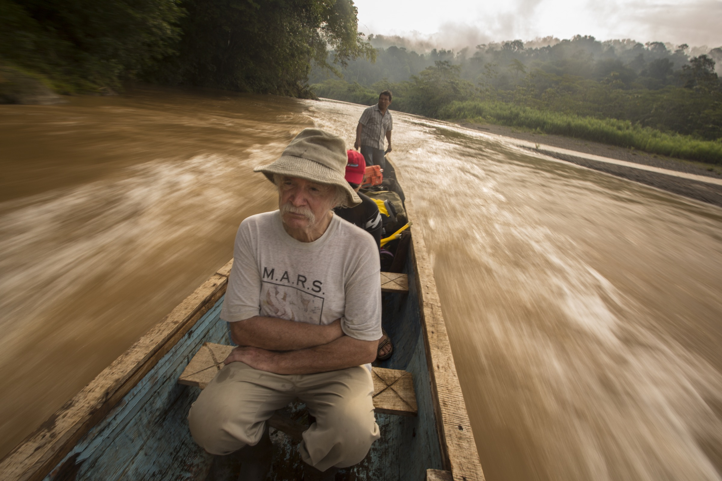 Bill McLarney, Maribel Mafla, and a Bribri guide travel up the Rio Yorkin by motorized canoe.