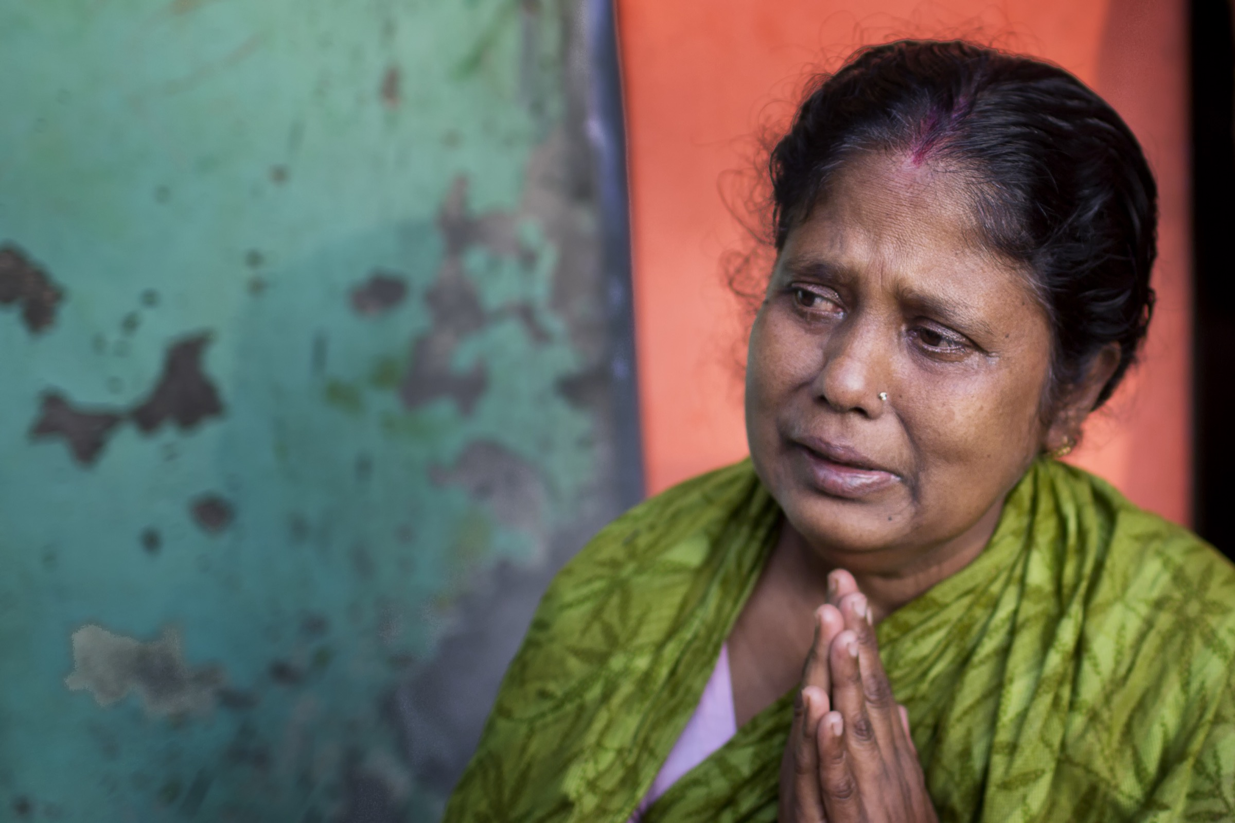 Since 2001, when Nipah virus was first recognized in Bangladesh, the pathogen has taken a heavy toll. This mother in Faridpur prays for her son who fell ill after drinking date palm sap during a gathering to celebrate his graduation from high school. He has since died. Photograph by A.M. Ahad