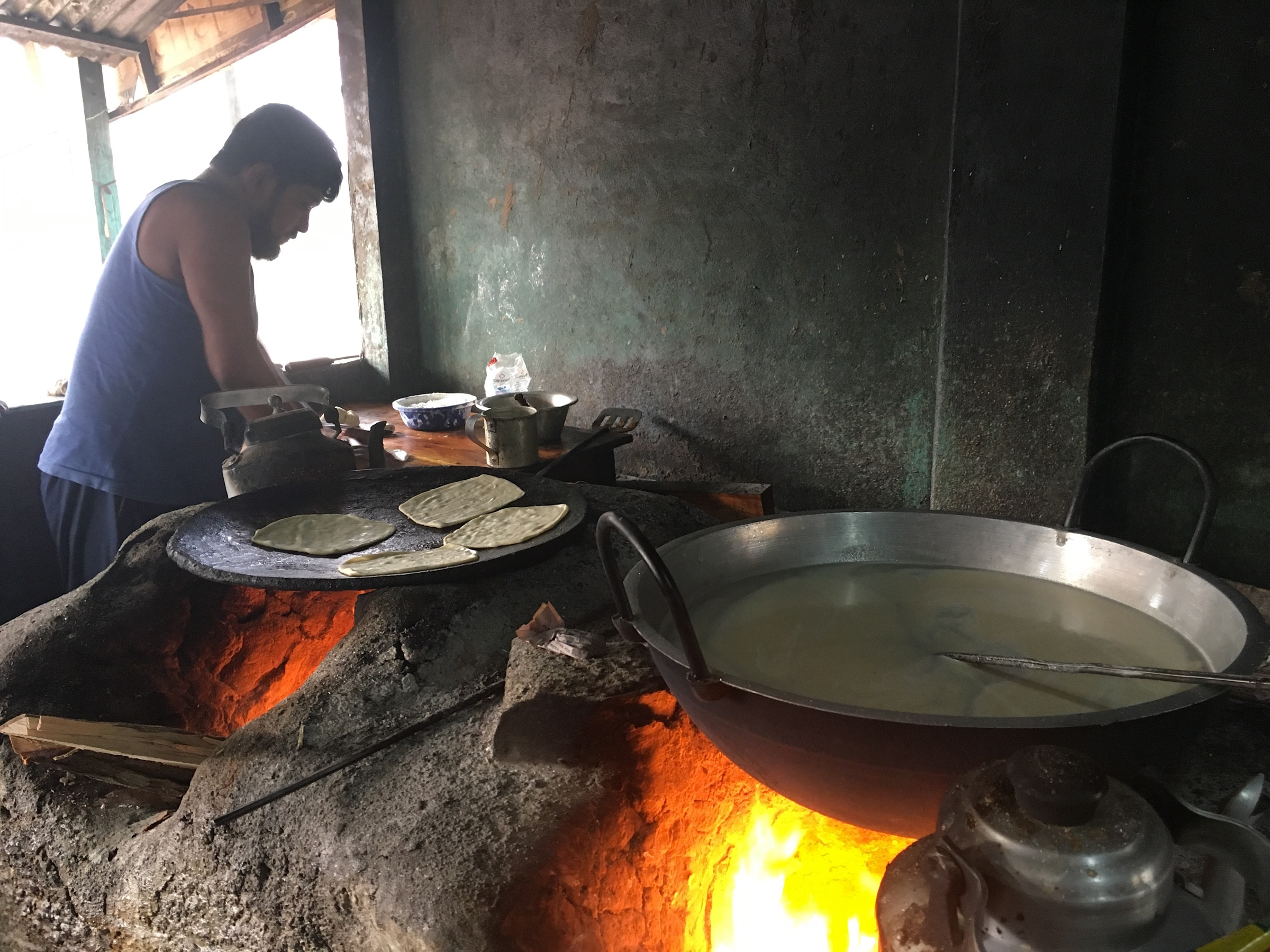 It's not hard to find a meal in Rangpur city. Nearly everywhere you look, vendors are cooking traditional meals over wood fires and propane stoves. Photograph by Steven Bedard
