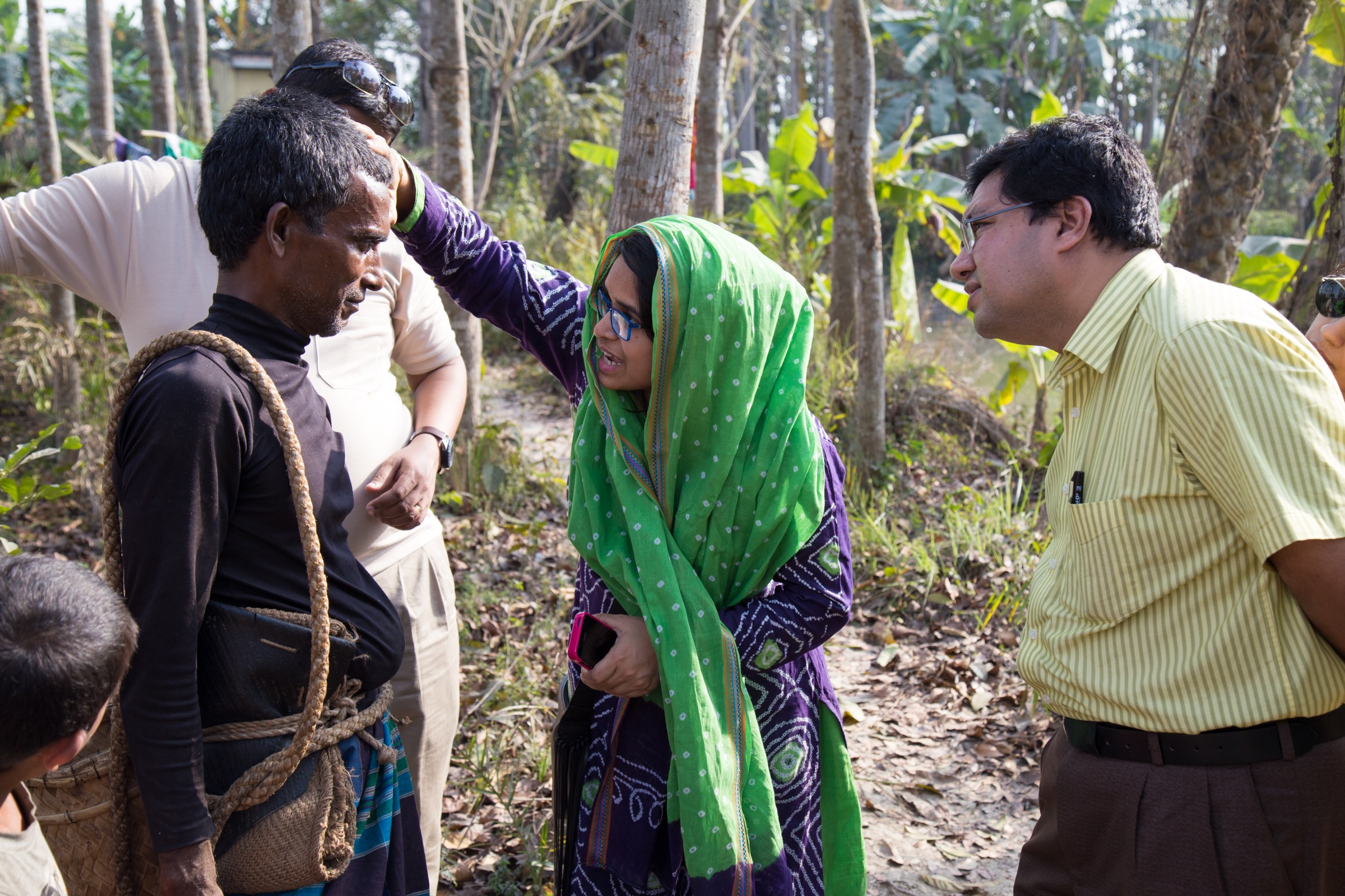 Arifa Nazneen and Hossain M. S. Sazzad, members of ICDDR,B Nipah surveillance team, conduct a physical examination of a gachhi in Bangladesh's Faridpur District. Photograph by Steven Bedard