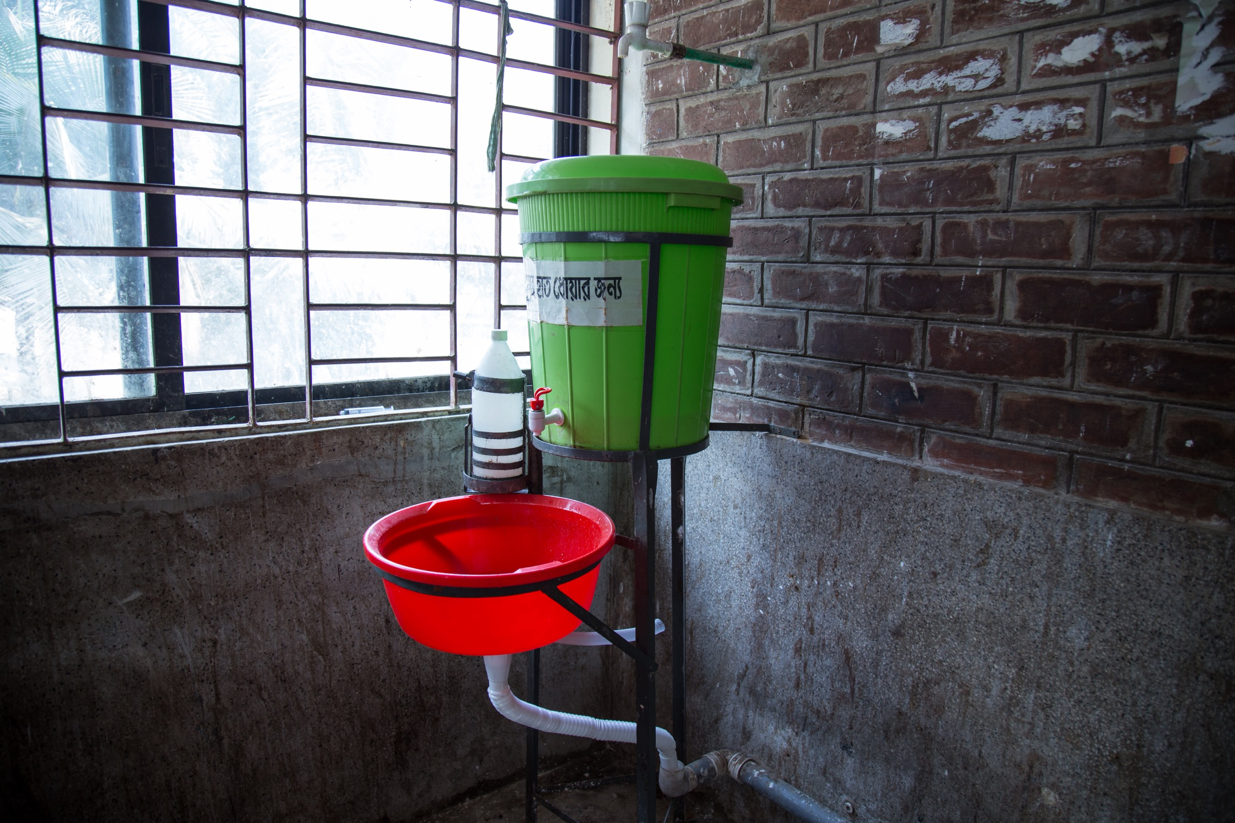 While it's not the source of hot, running water that one might expect in a hospital, this wash basin in Faridpur Medical College Hospital at least provides some means of sanitation for staff and family caregivers—as long as people use them. Photograph by Steven Bedard