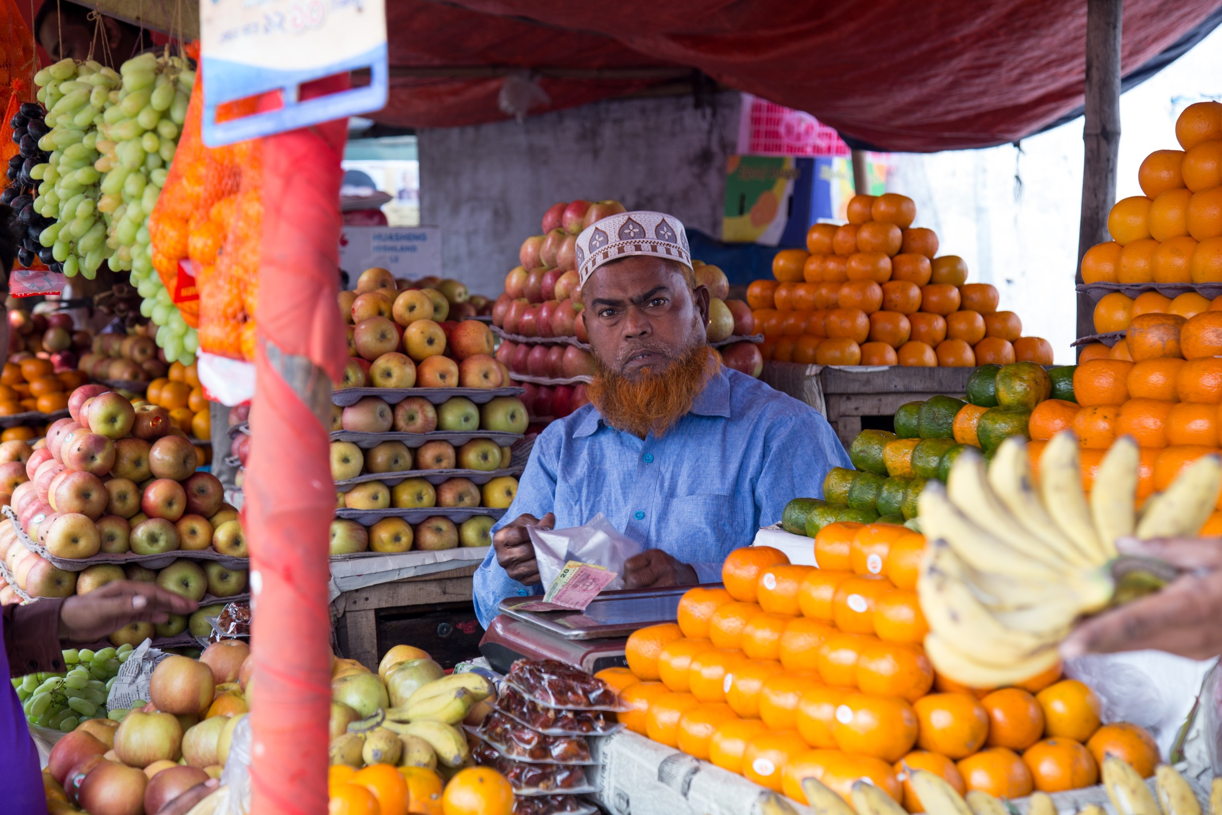For a city most people have never heard of, northern Bangladesh's Rangpur City is a bustling place that wakes up early each morning to offer fresh fruit, mobile phones, and just about anything else you could desire. Photograph by Steven Bedard