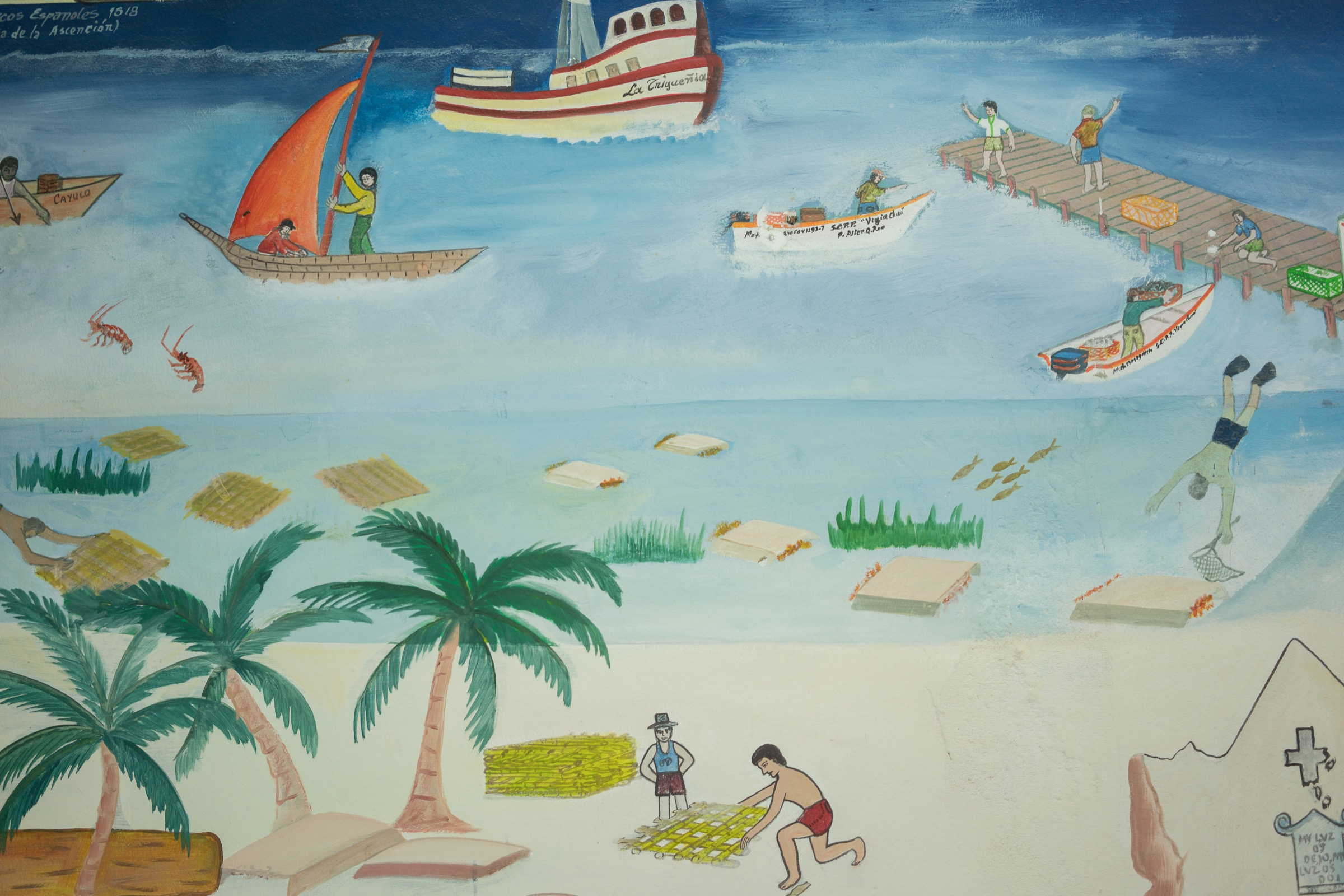 A painting at the offices of La Cooperativa Pesquera de Vigia Chico, a fishing cooperative in Punta Allen, illustrates the importance of lobster fishing to the area and depicts historical versions of lobster traps. Photograph by Dominic Bracco II