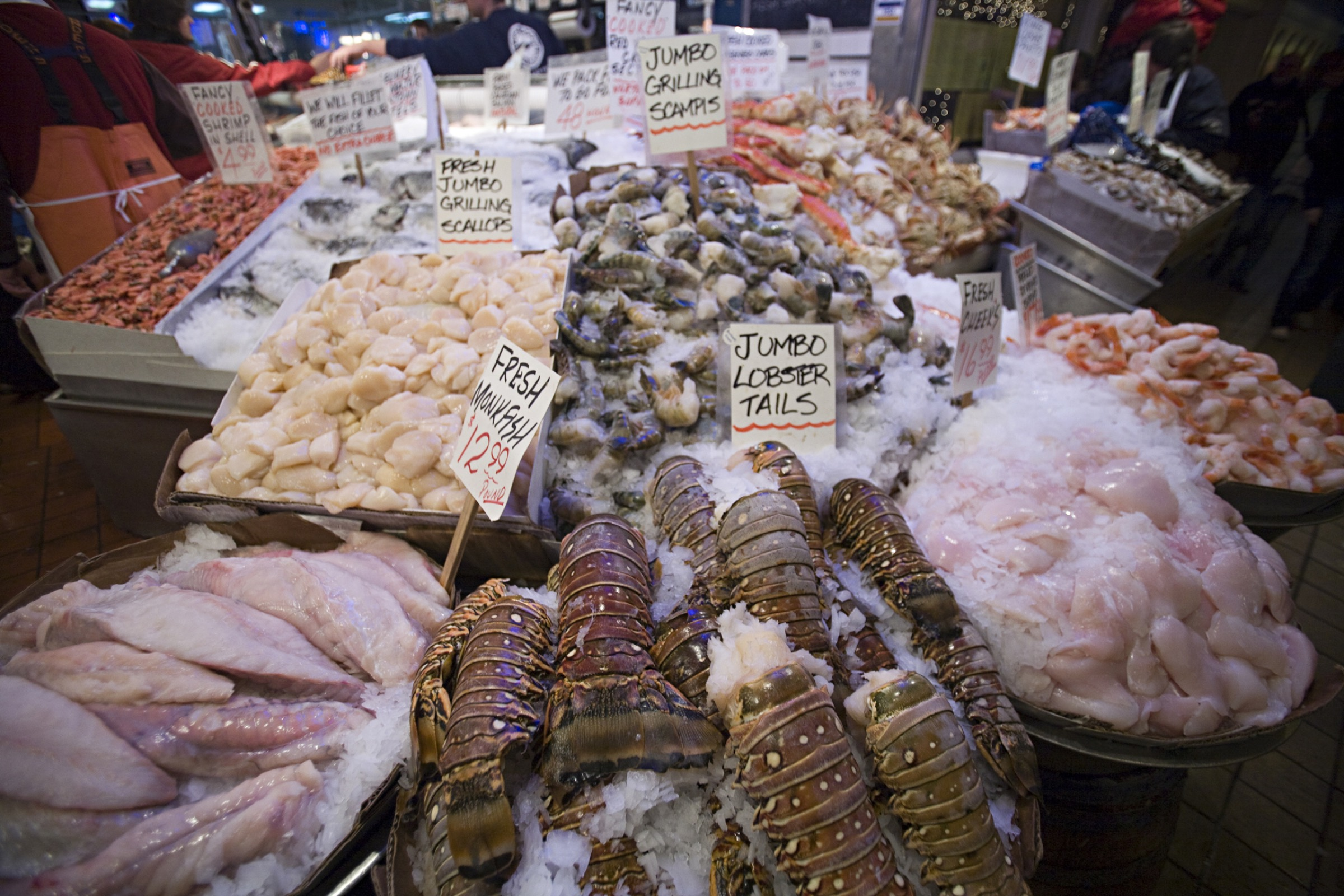 A variety of seafood is displayed on ice at the Pike Street Market in Seattle, Washington. Photograph by Aaron Black