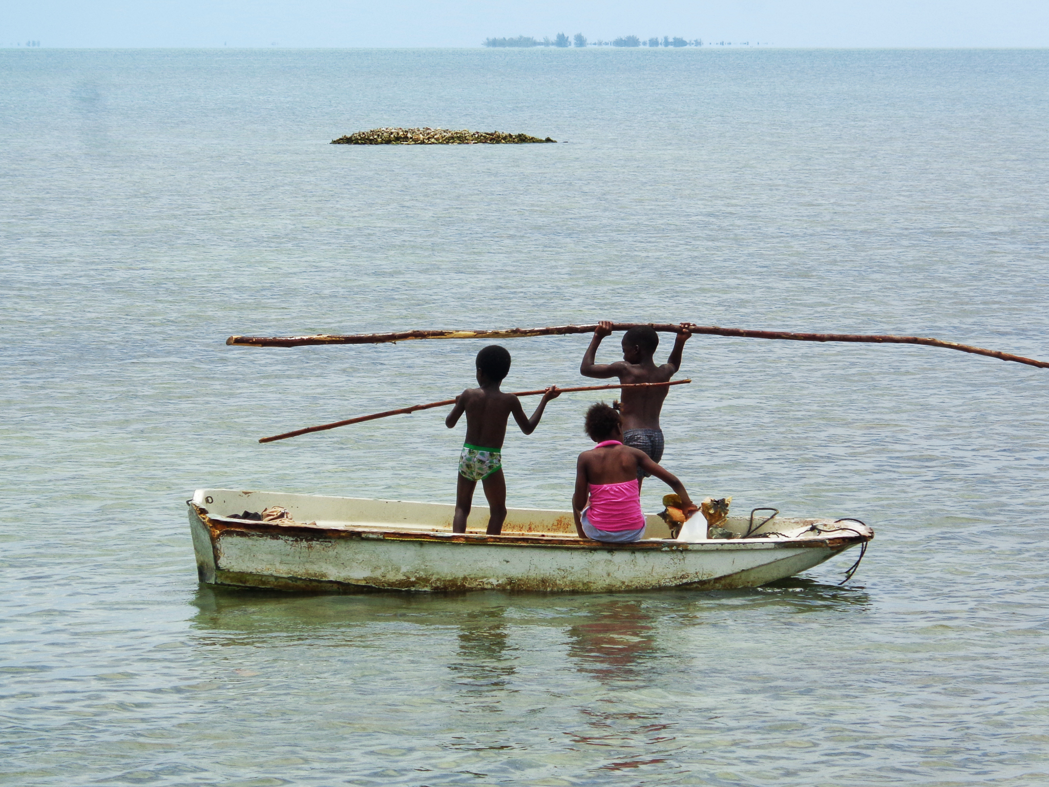 Young Androsians play just offshore. The island they eventually inherit will be greatly impacted by decisions made today about which things to value most. Photograph by Ann-Sophie Gabellini