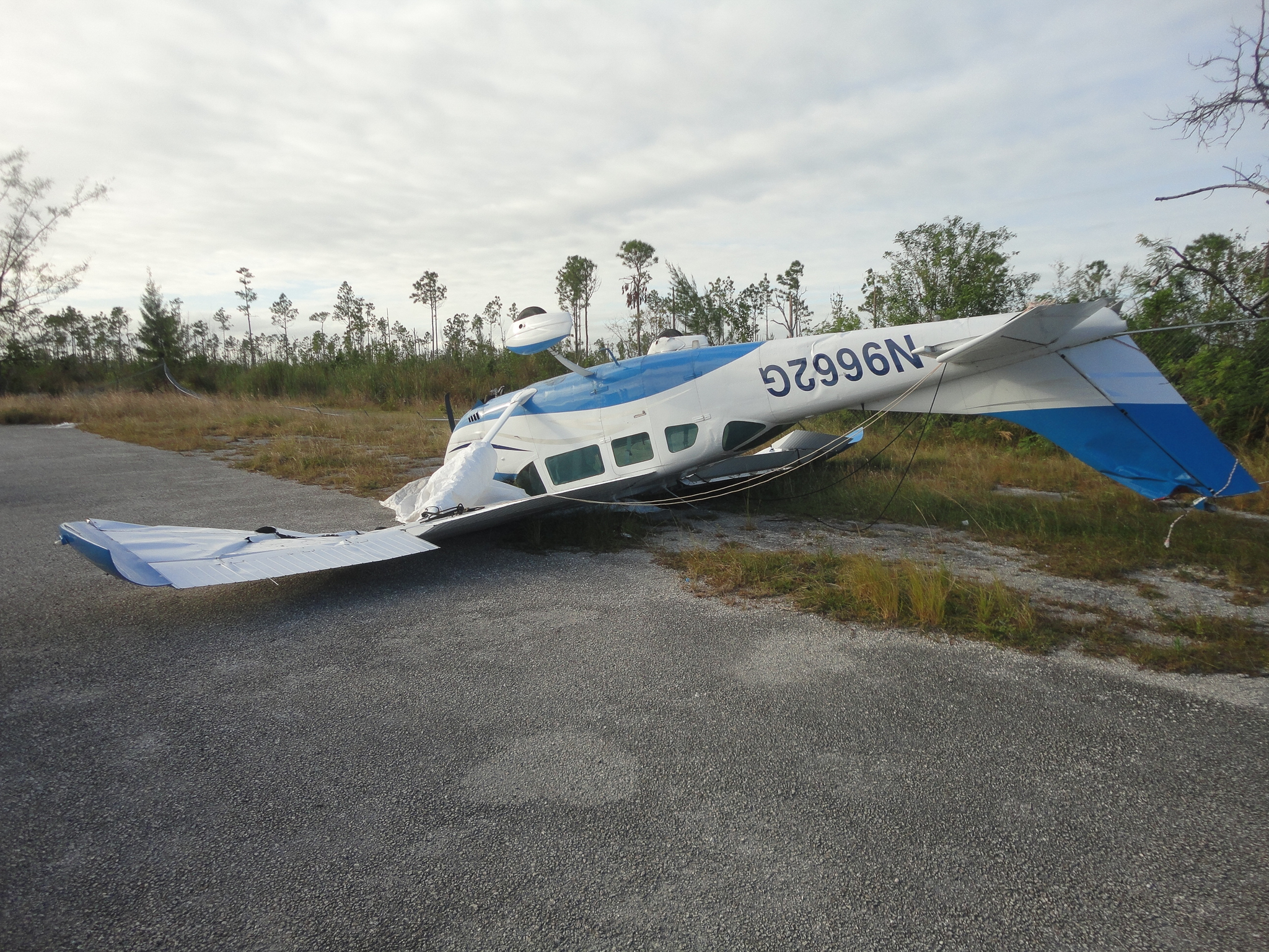 A toppled plane remains months after Hurricane Matthew wreaked havoc on Andros Island. Photograph by David Brian Butvill