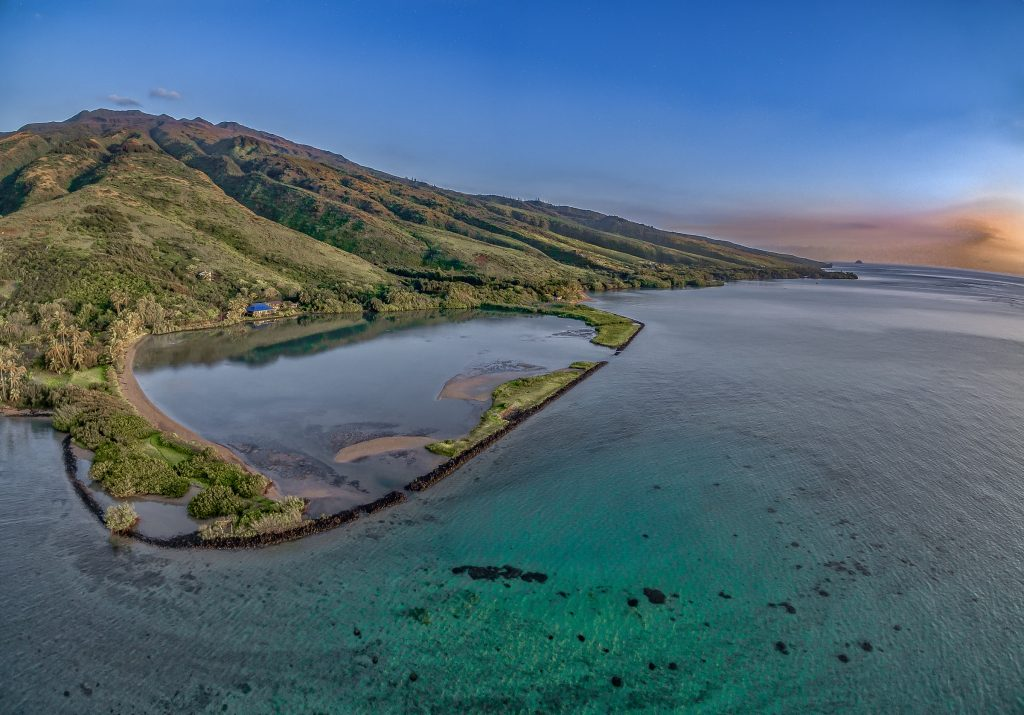 Aerial view of the Kupeke fishpond along Molokai's southeast shoreline. Photograph by Mickey Pauole