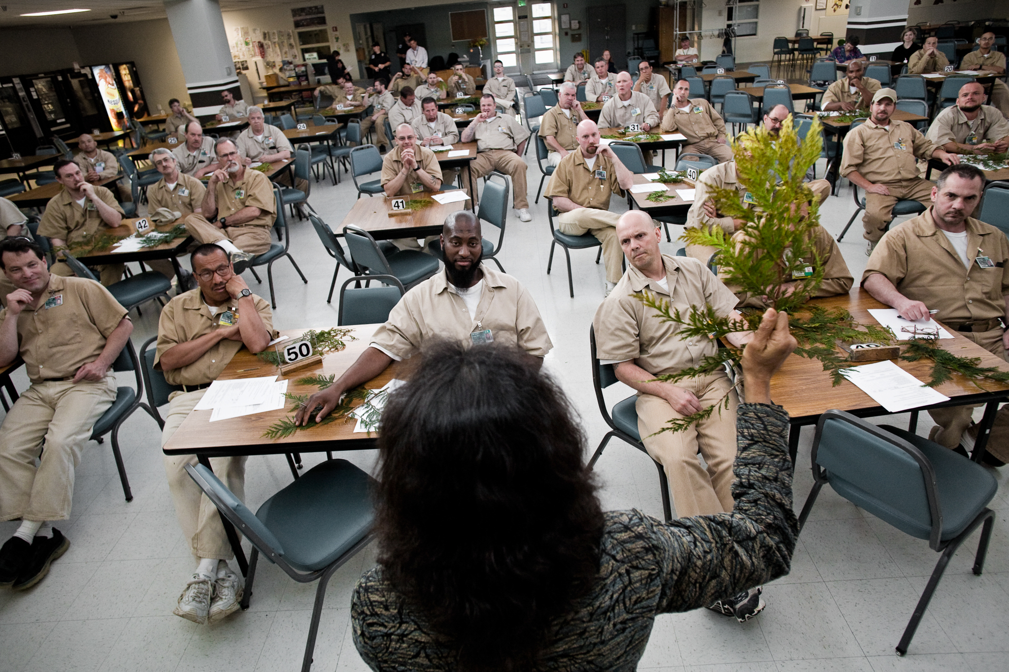 Sustainability in Prisons Project cofounder and forest ecologist Nalini Nadkarni lectures inmates about trees. Photograph by Benjamin Drummond.