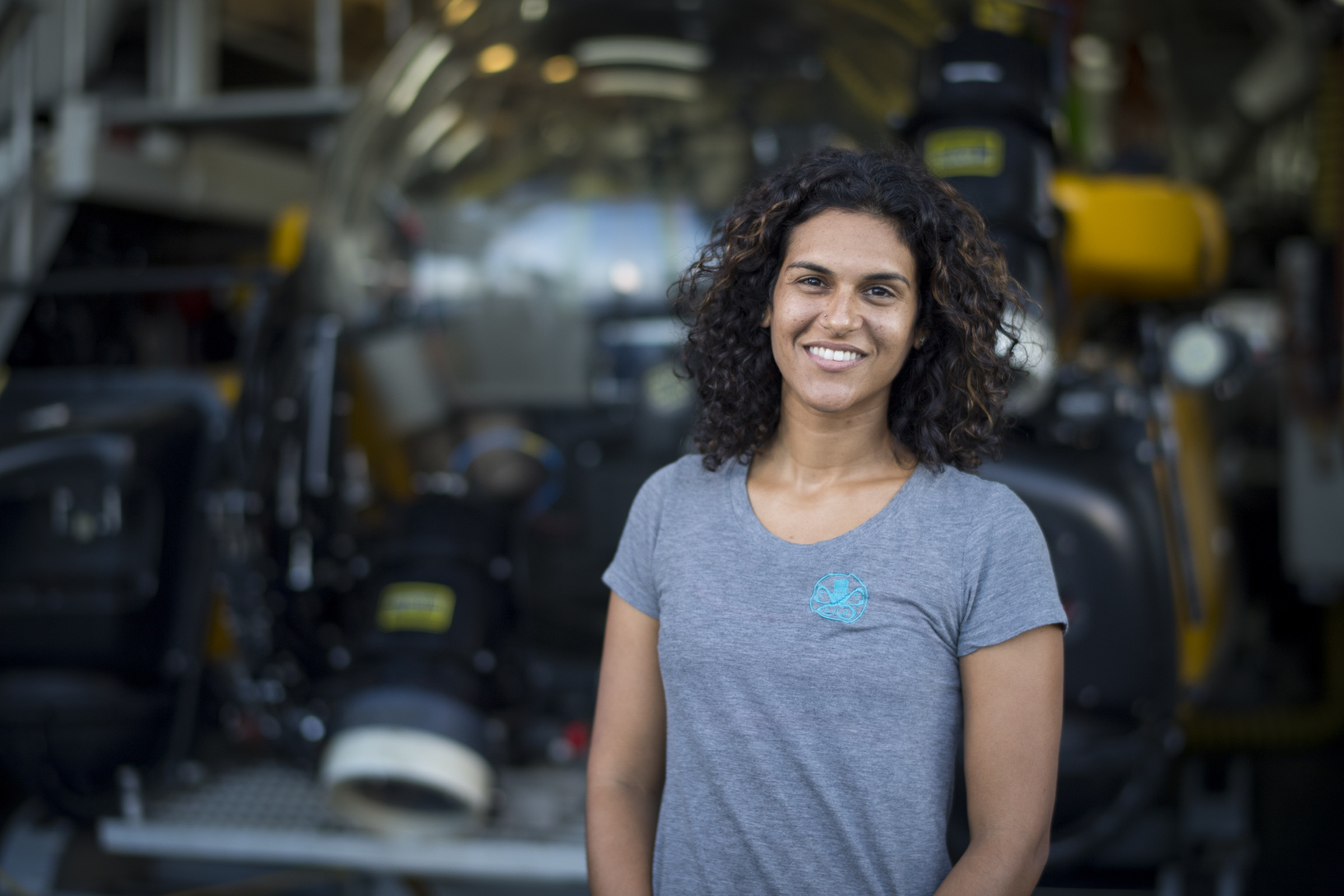 Diva Amon, a marine biologist from the Natural History Museum of London, UK, stands in front of one of the submersibles she has used to study life around deep hydrothermal vents. Photograph by Novus Select