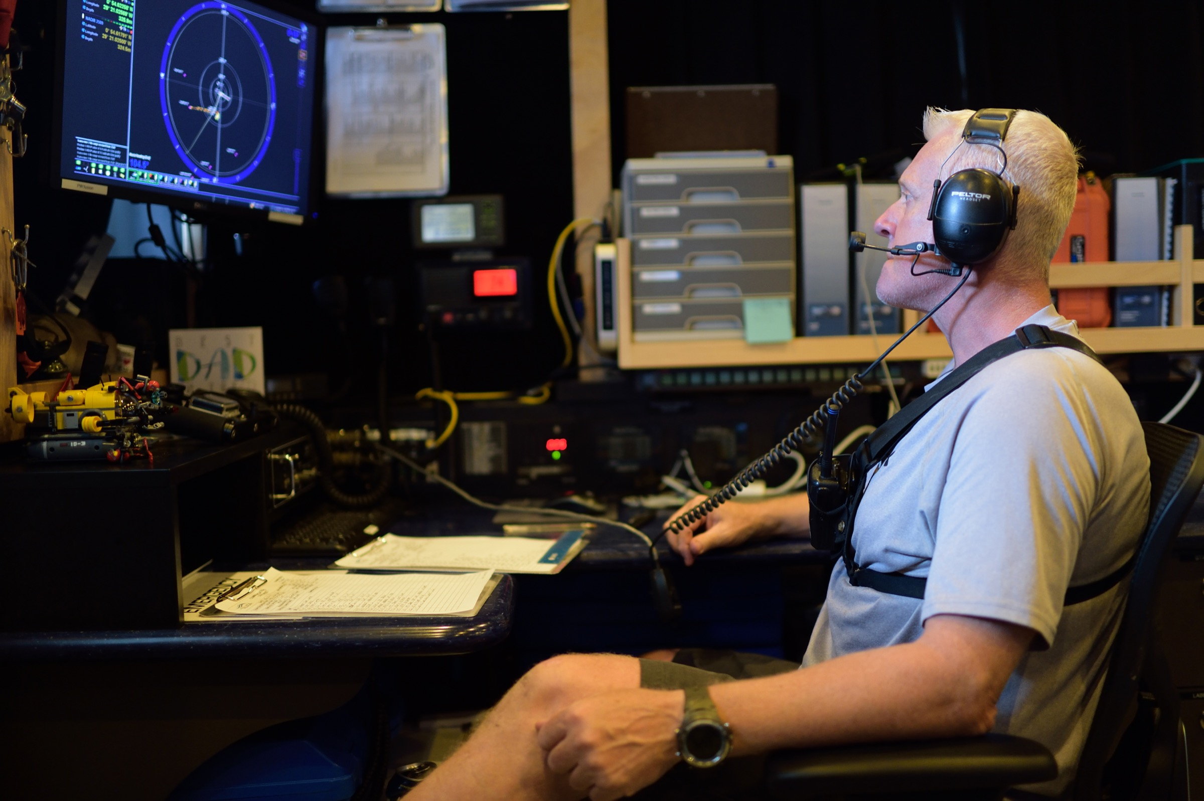 Submarine team leader Alan Scott keeps a close eye on video monitors in the control room onboard the M/V Alucia. Photograph by Solvin Zankl