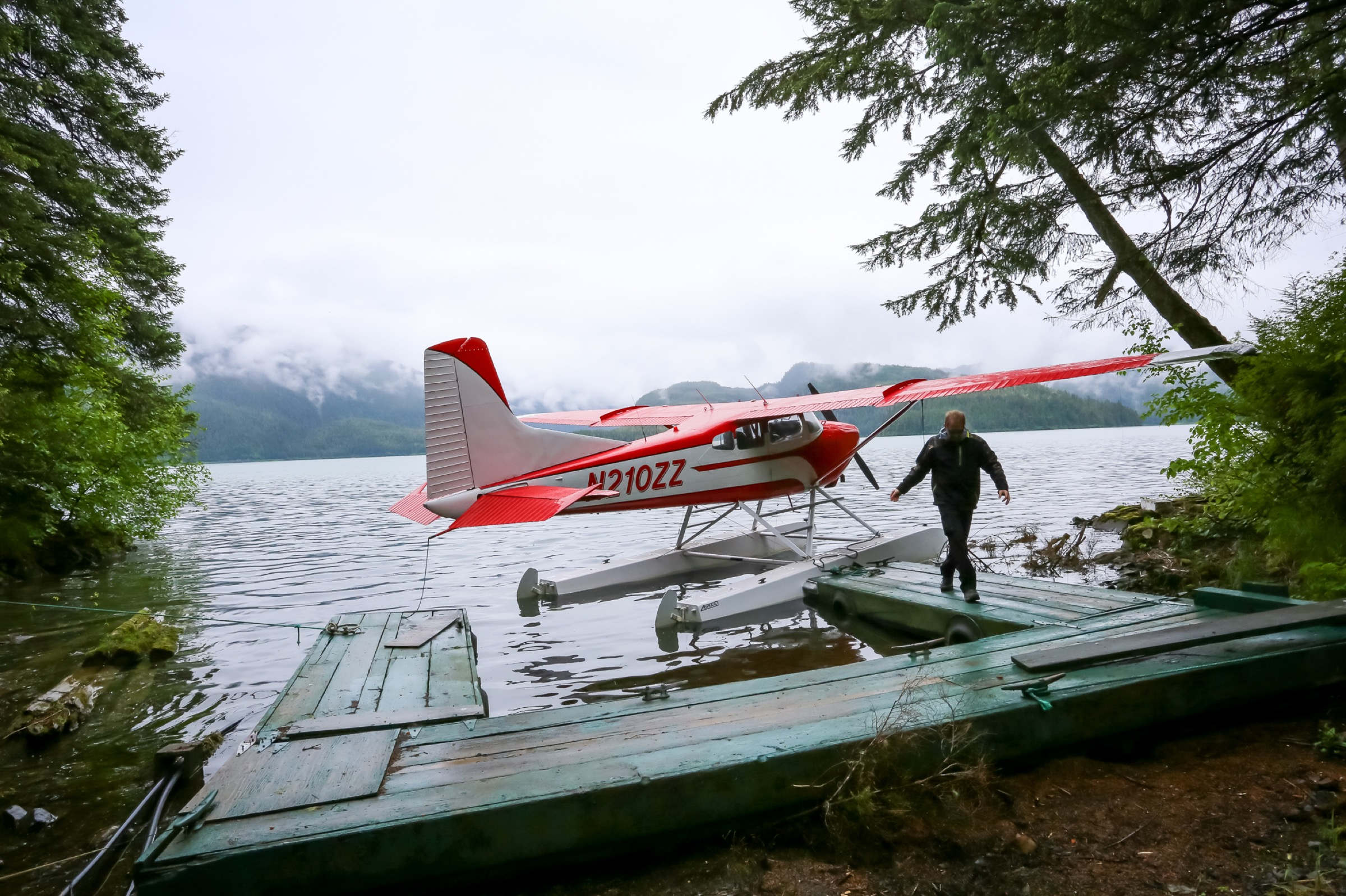 In Eyak Lake, pilot Mike Collins readies his float plane for a flight. Photograph by Julia Rosen