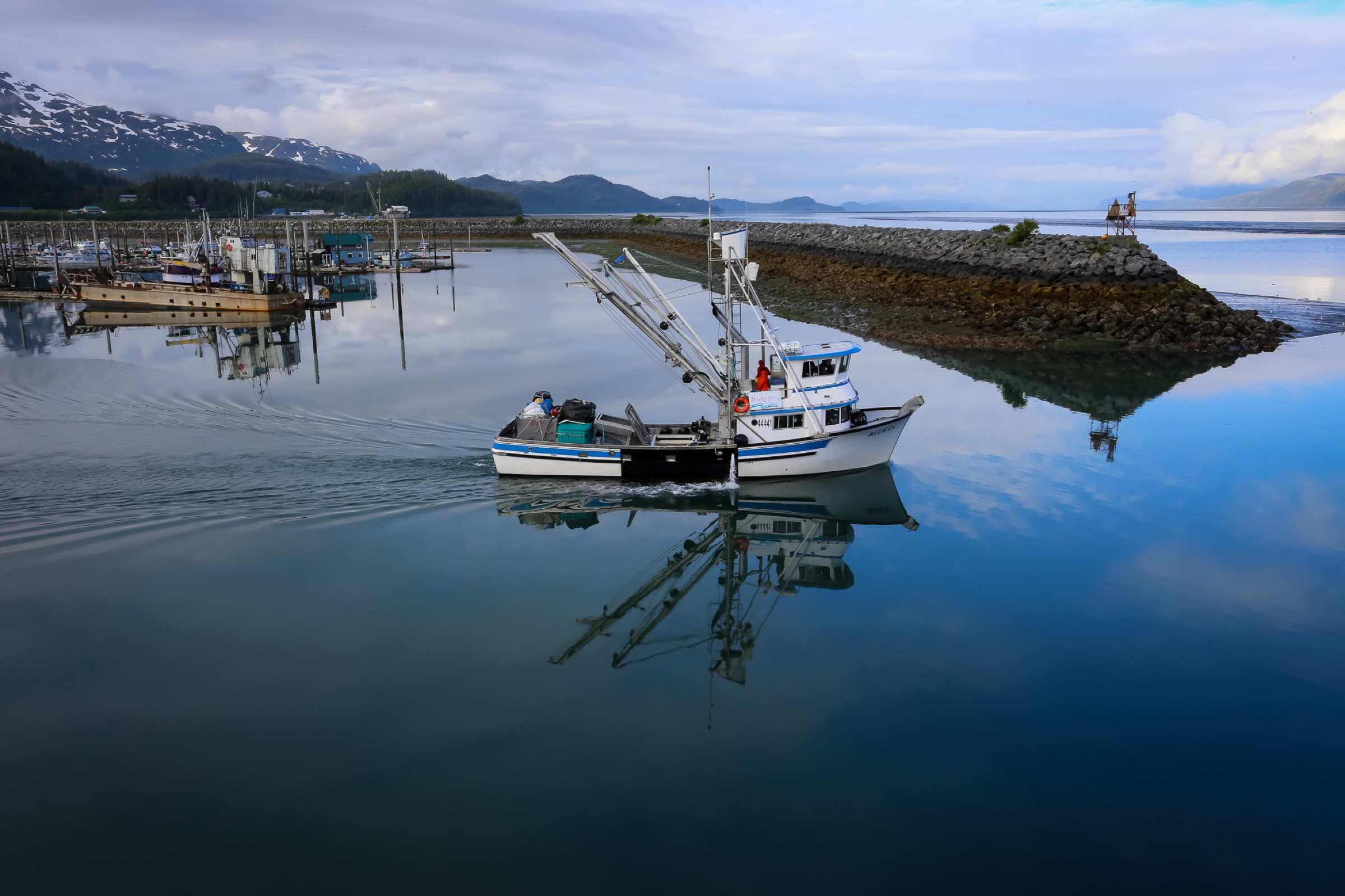 A non-operational fishing boat heads out of Cordova harbor. Photograph by Julia Rosen