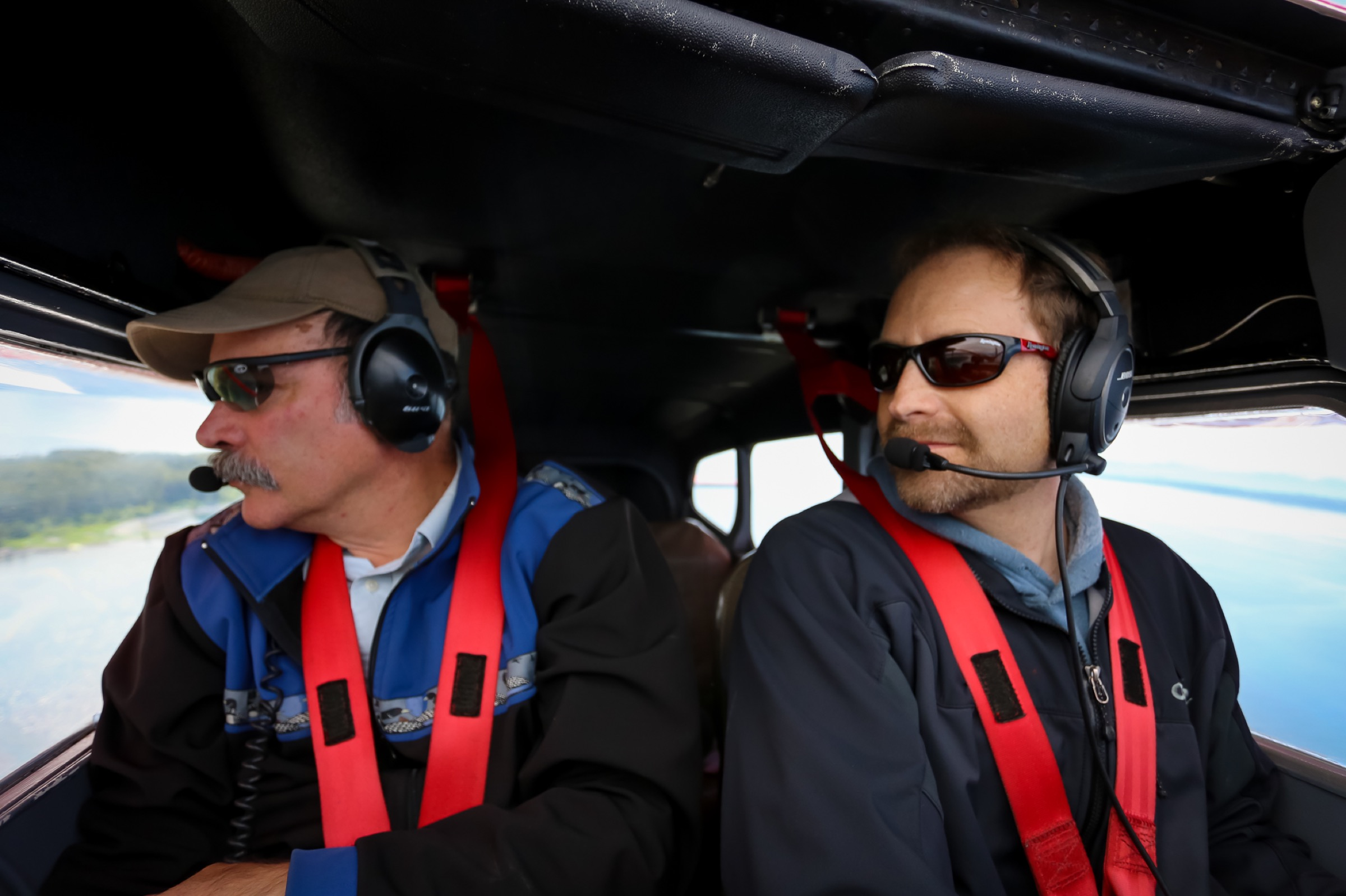 Scott Pegau and pilot Mike Collins search for herring above Prince William Sound. Photograph by Julia Rosen
