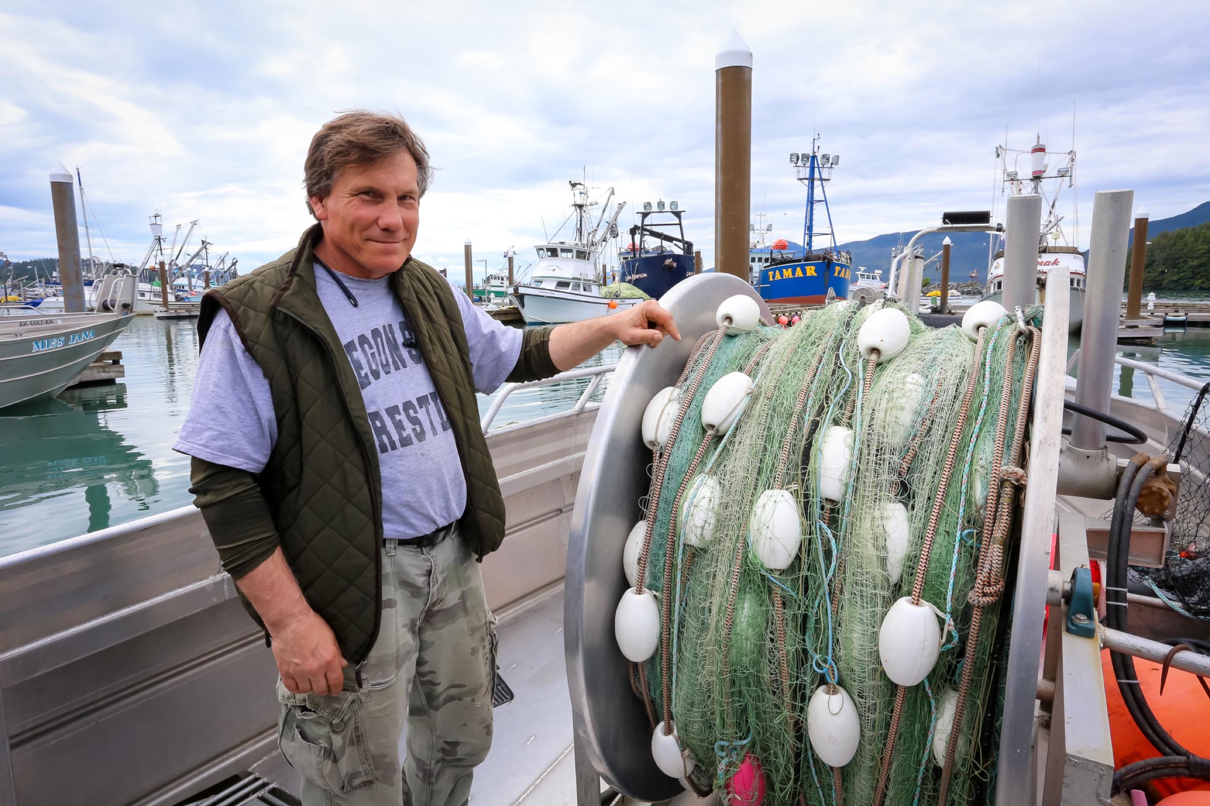 John Platt stands aboard his salmon gillnet boat, the Kokenhenic. Photograph by Julia Rosen