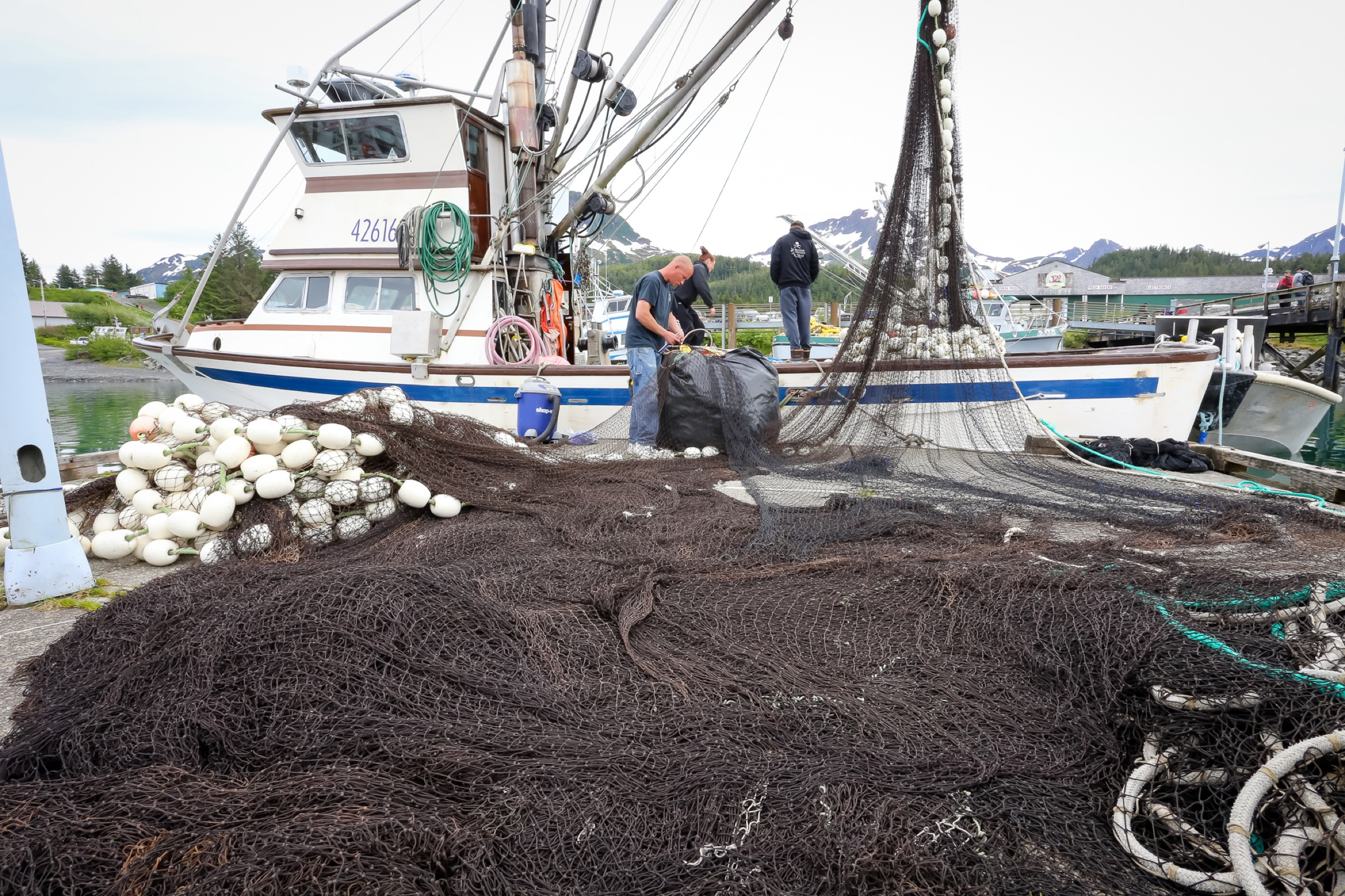 John Renner's crew mends nets in preparation for an upcoming salmon opener. Photograph by Julia Rosen