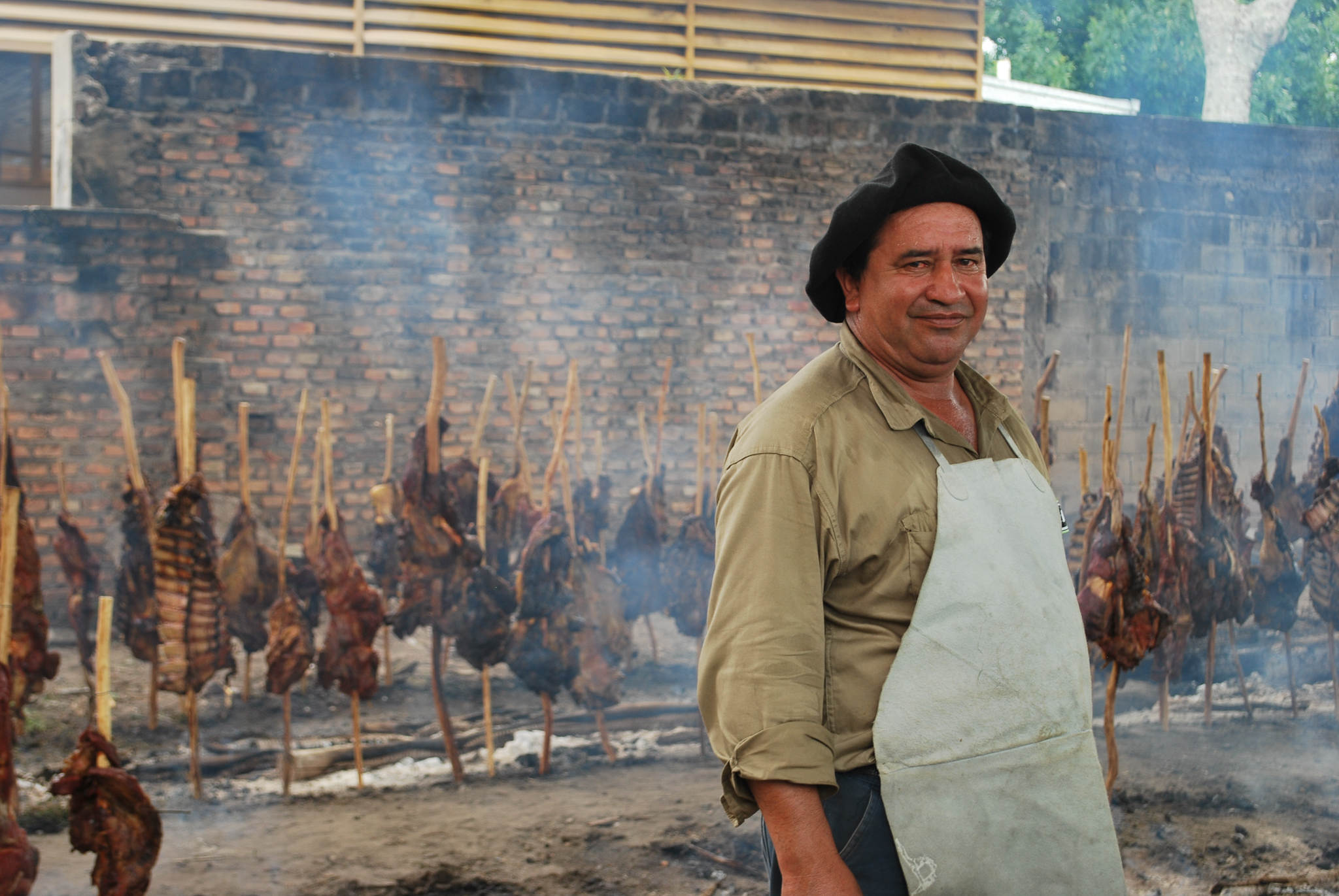 A proud barbecuer in the city of Concepción, del Yaguareté Corá, where volunteers prepared meat for a crowd of hundreds celebrating the Day of the Virgin—Photo by Brooke Jarvis