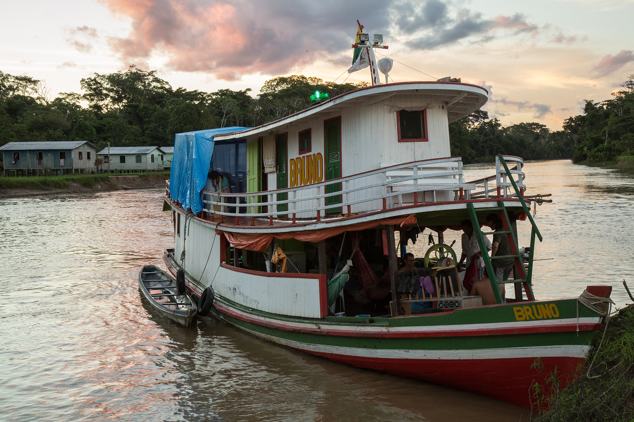 The houseboat which serves as a floating field station docks at Santa Catarina on the Rio Liberdade during the final weeks of the expedition. The expedition team spends two to five days in and around each community, surveying the surrounding forests and waterways for wildlife.