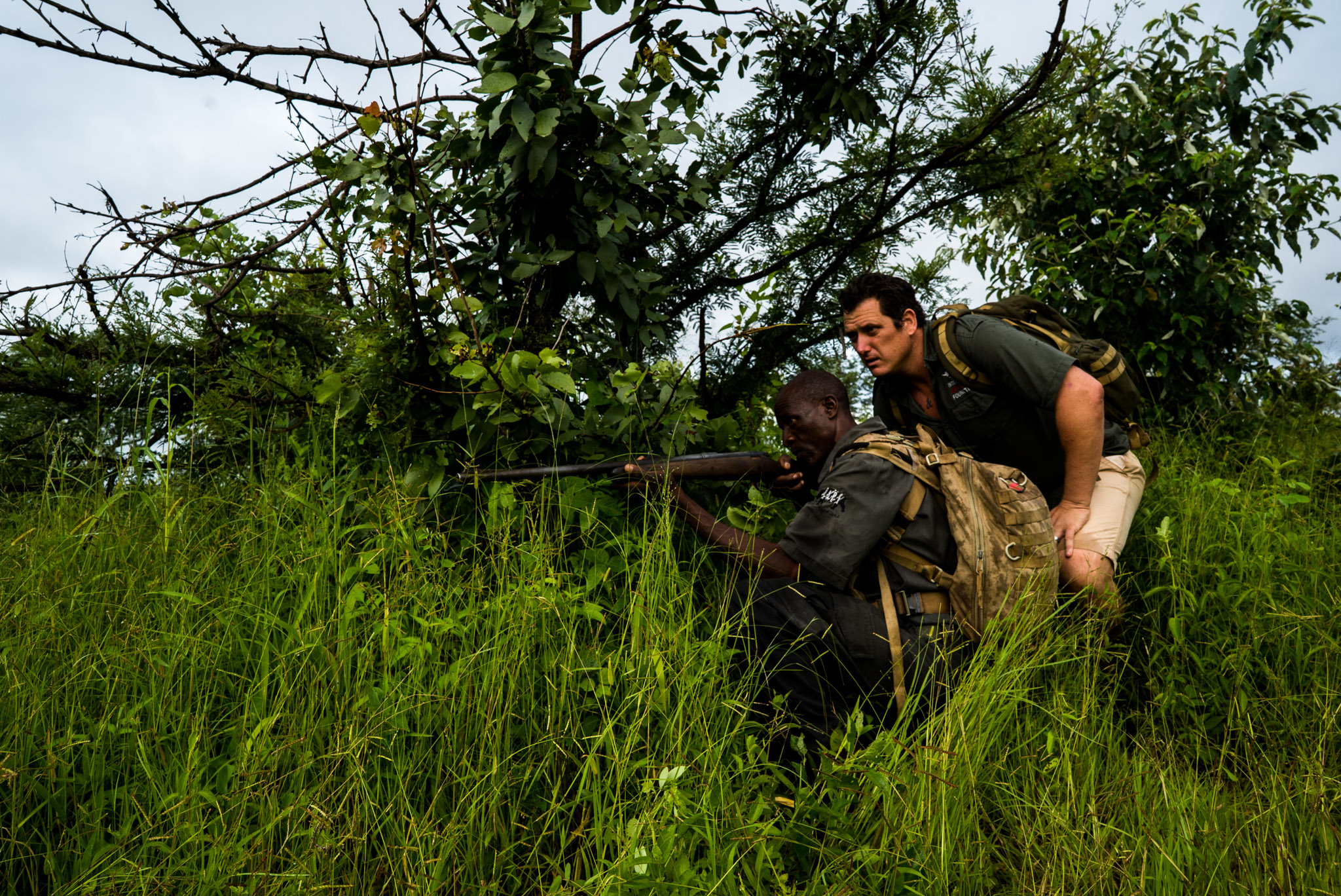 Damien Mander and IAPF ranger Tyson Mumpande in position while on dawn patrol in the Stanley and Livingstone Game Reserve, Zimbabwe—Photograph by Michael Hathorn, Ginkgo Agency