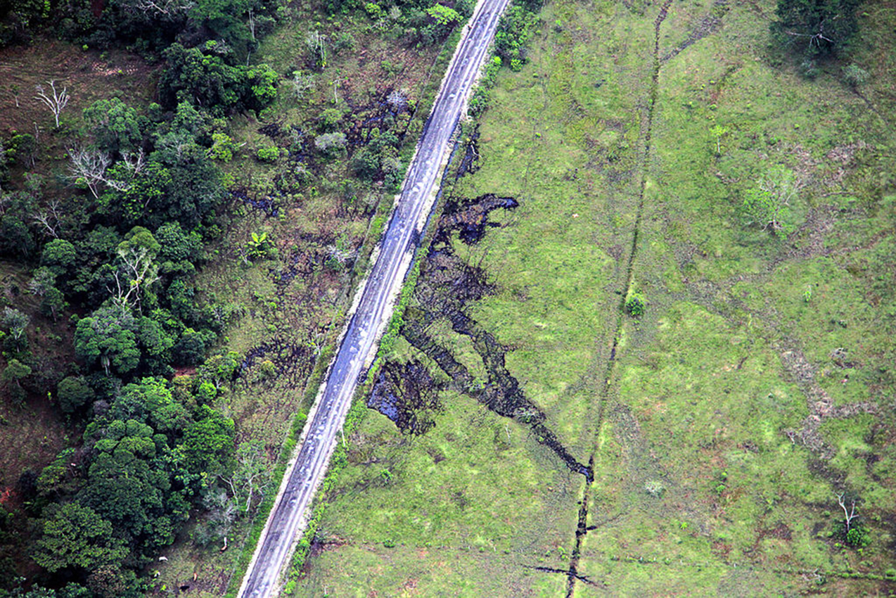 In a 2014 attack, the FARC intercepted a convoy of 19 oil trucks and forced the drivers to dump four thousand barrels of crude oil in the road. Photograph by César Mariño García / Pacific Press / LightRocket via Getty Images