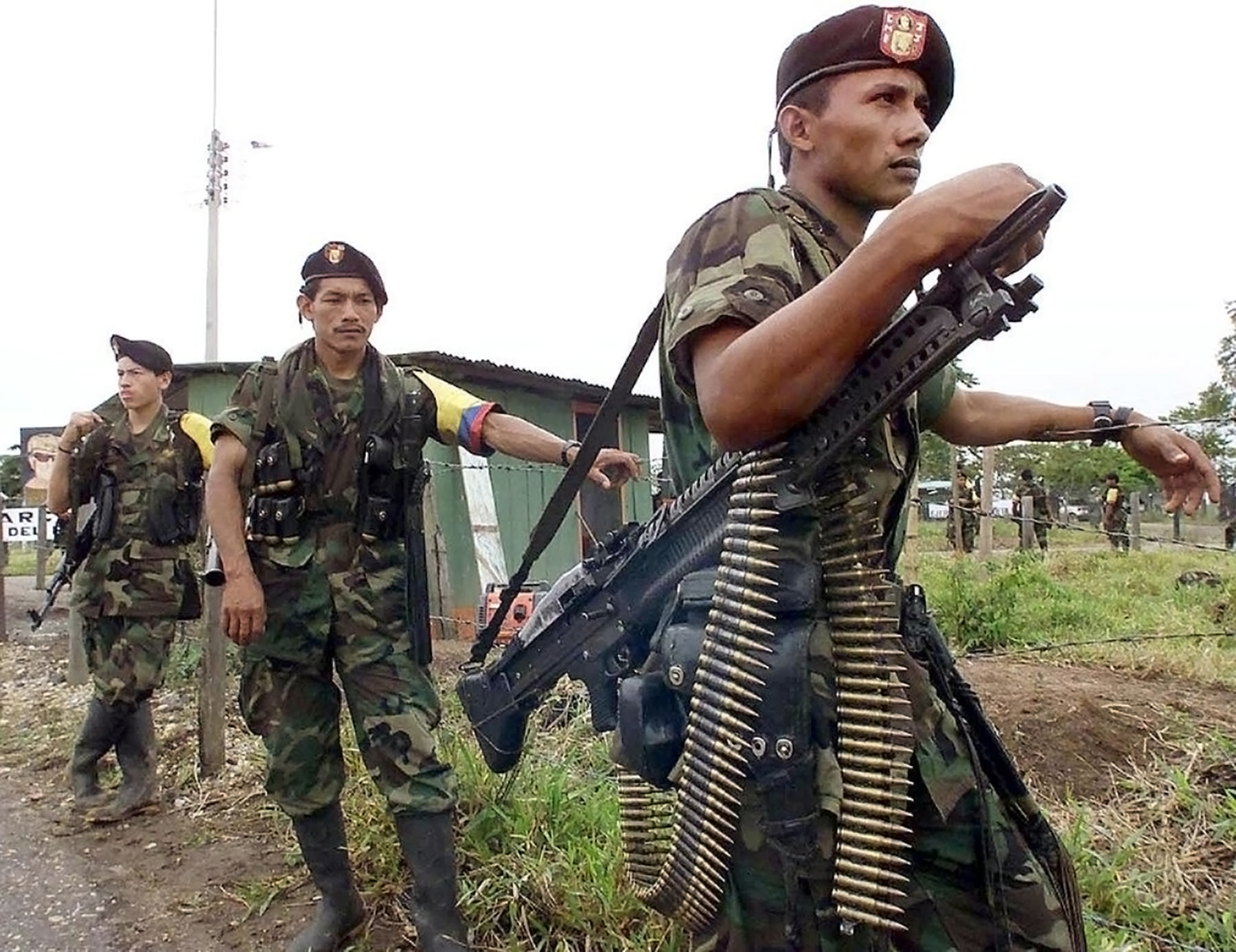 FARC guerrillas stand guard during talks between the rebel chief and the Colombian president in 2001. Photograph by LUIS ACOSTA / AFP via Getty Images