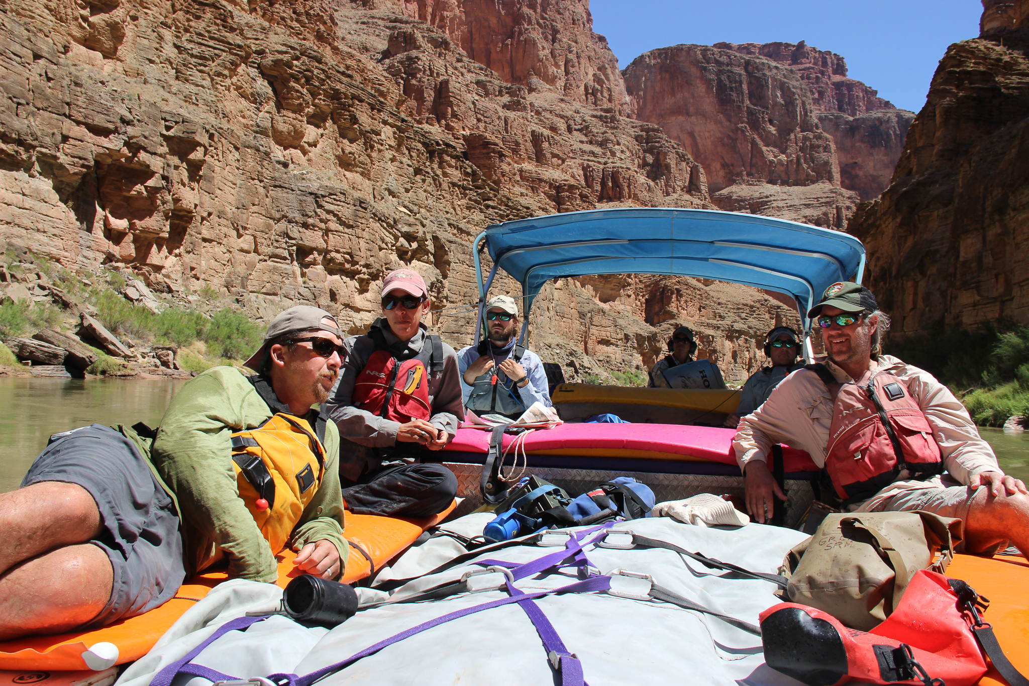 The team lounges on the raft during a moment of downtime between seining sites—and between stretches of whitewater.