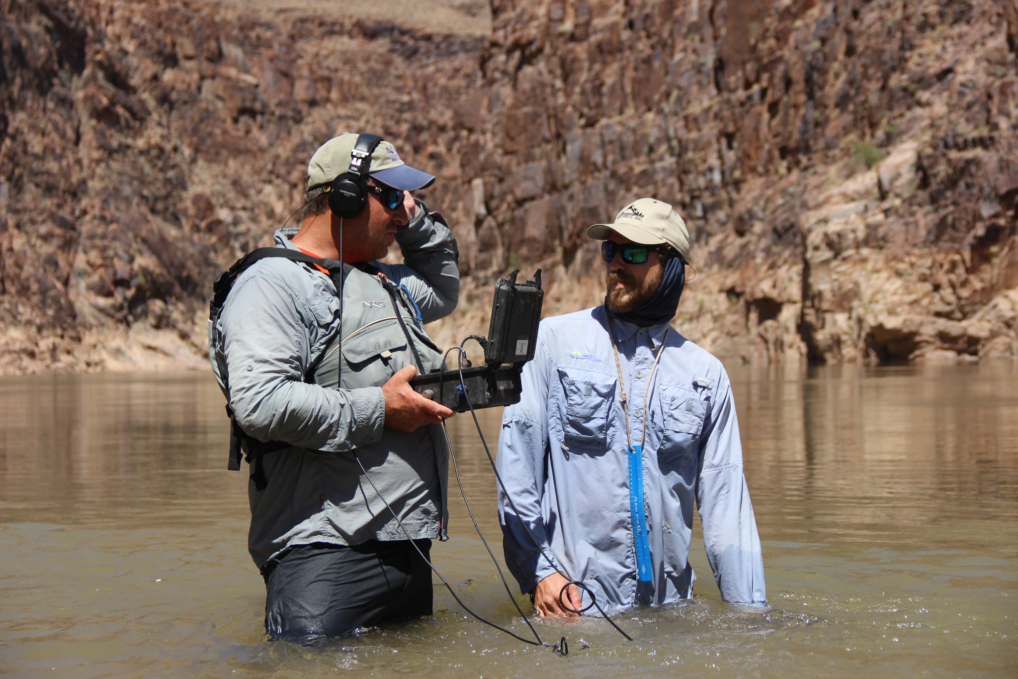 Brandon Albrecht and Mike Edwards use a hydrophone to listen for the pings of radio-tagged razorback suckers. In 2012, biologists captured an adult razorback in the Grand Canyon, fifty miles from Lake Mead, for the first time in decades.