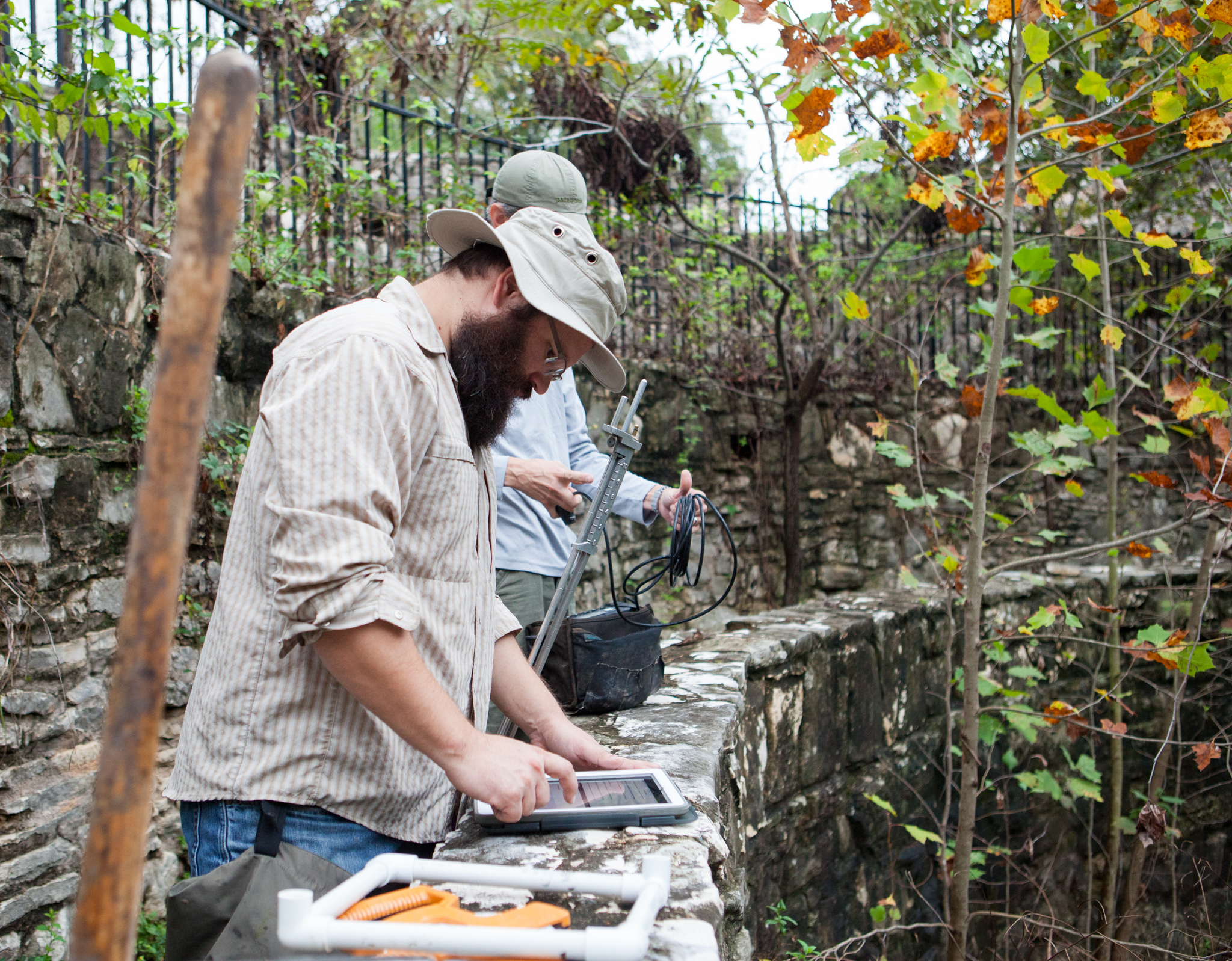 Nate Bendik, foreground, and Tom Devitt prepare their equipment before a survey for Barton Springs salamanders at Sunken Garden in Austin's Zilker Park. Both are salamander biologists employed by the city.