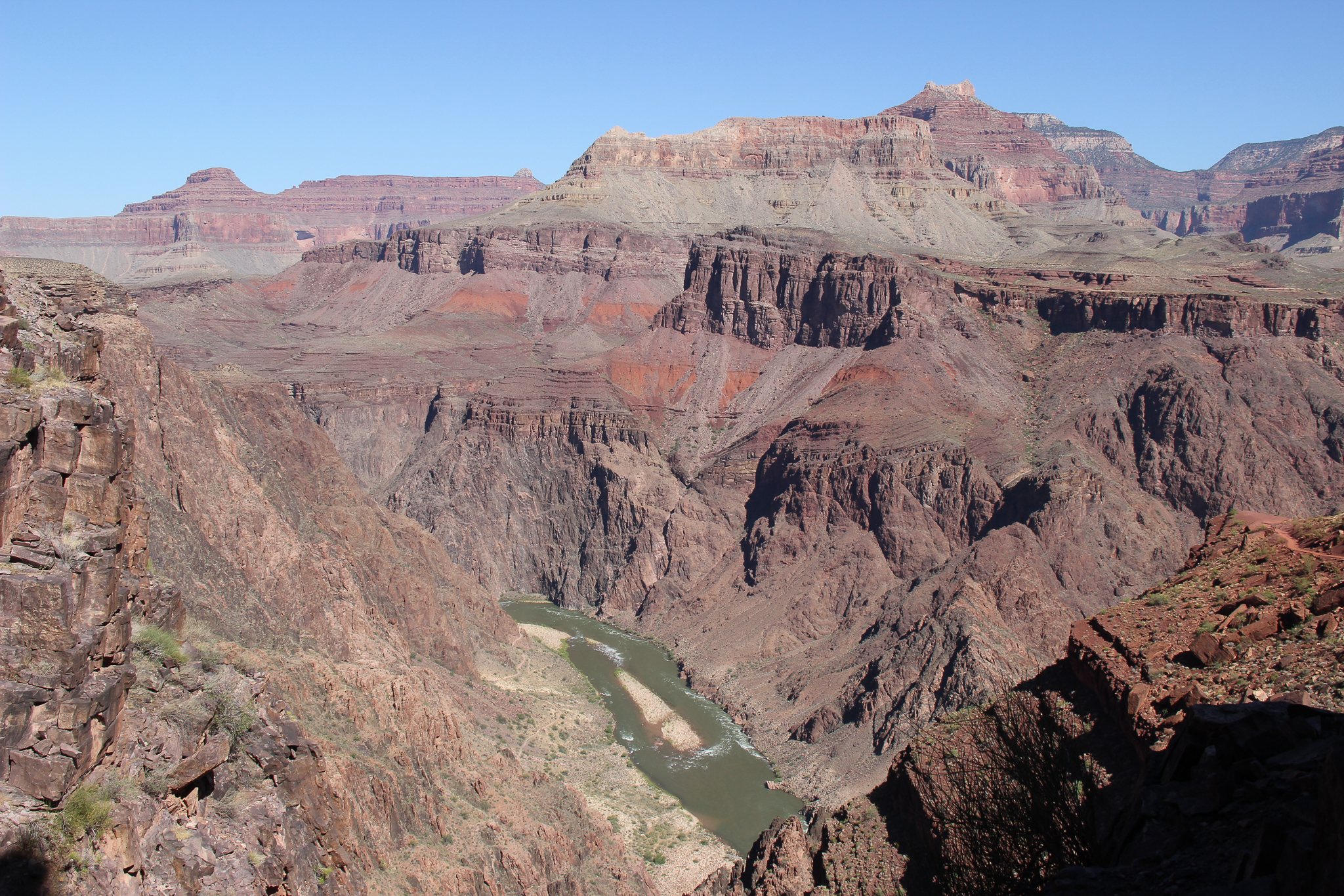The Colorado River lies far below this outlook along the South Kaibab Trail—a seven-mile descent into the Grand Canyon.