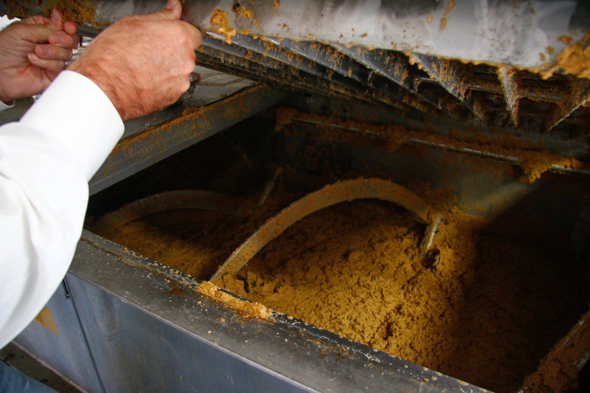 Glen Courtright peers inside the factory's porridge mixer.