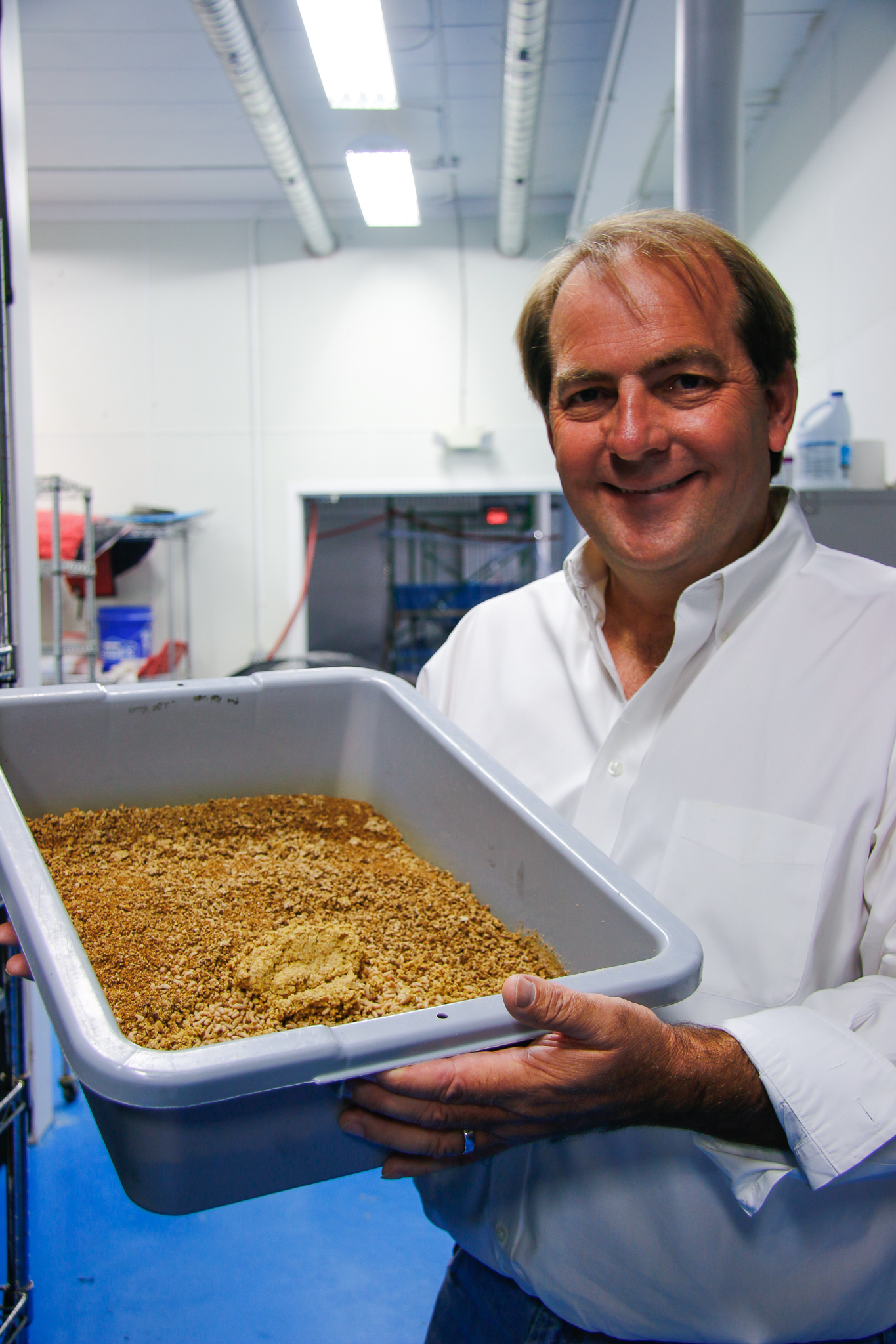 EnviroFlight CEO and founder Glen Courtright holds a bin of black soldier fly larvae inside his Ohio factory. In 2016, Courtirght's company was acquired by synthetic biology giant Intrexon.