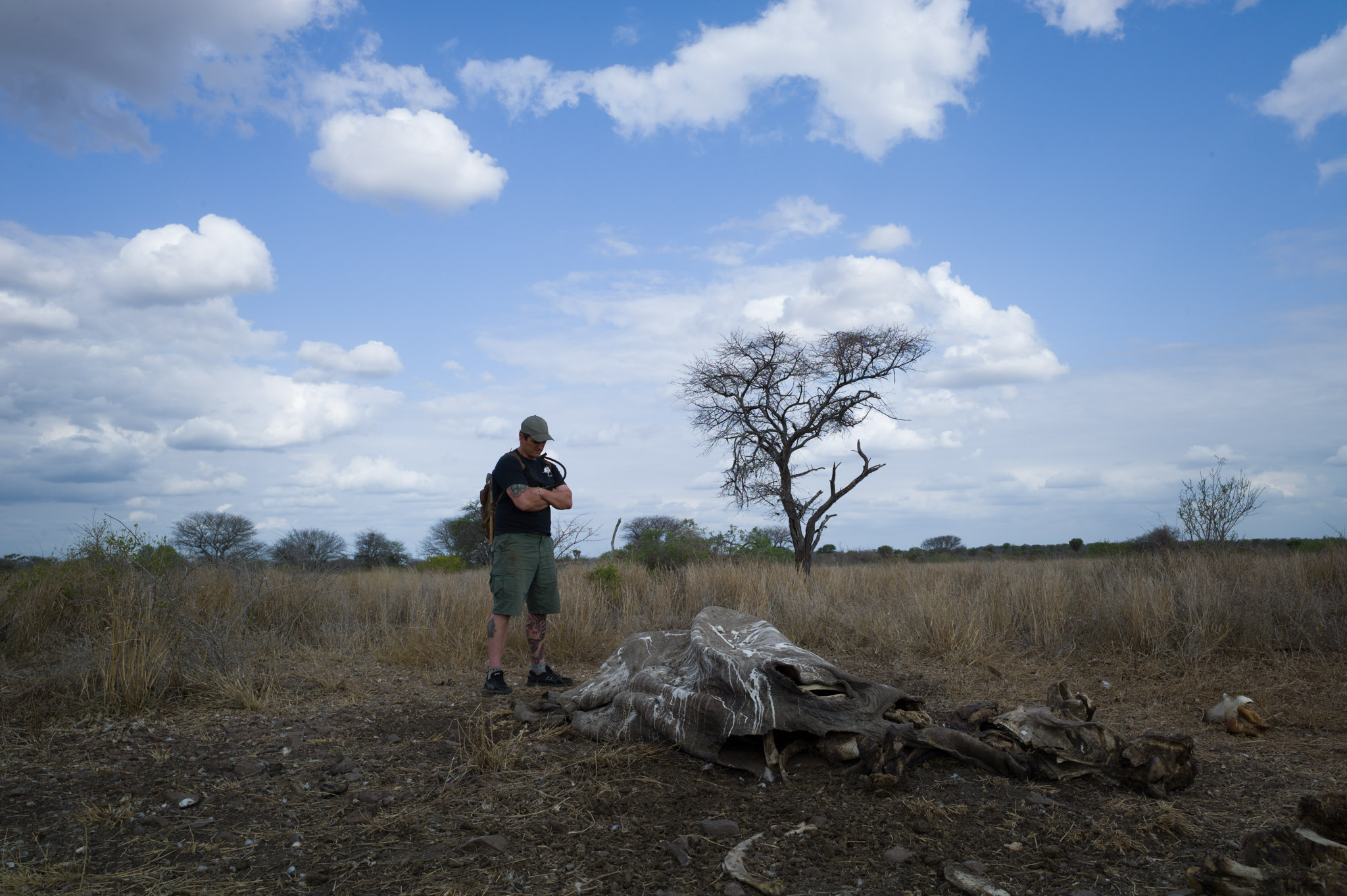 "Damien Mander inspects the remains of a rhino killed by poachers in the Greater Lebombo Conservancy, Mozambique. ""We have to be right 100% of the time,"" says Mander, referring to the extreme challenge of protecting rhinos 24/7. ""Poachers need to be right once."" Photograph by Erico Hiller"