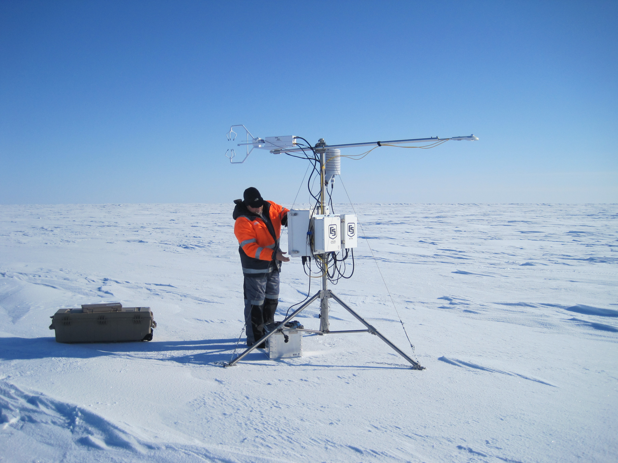 A researcher makes final adjustments to an instrument that takes measurements of wind and temperature 20 times per second—helping scientists understand the atmosphere's effects on sea ice. Photograph by Mats Granskog/Stephen Hudson, Norwegian Polar Institute