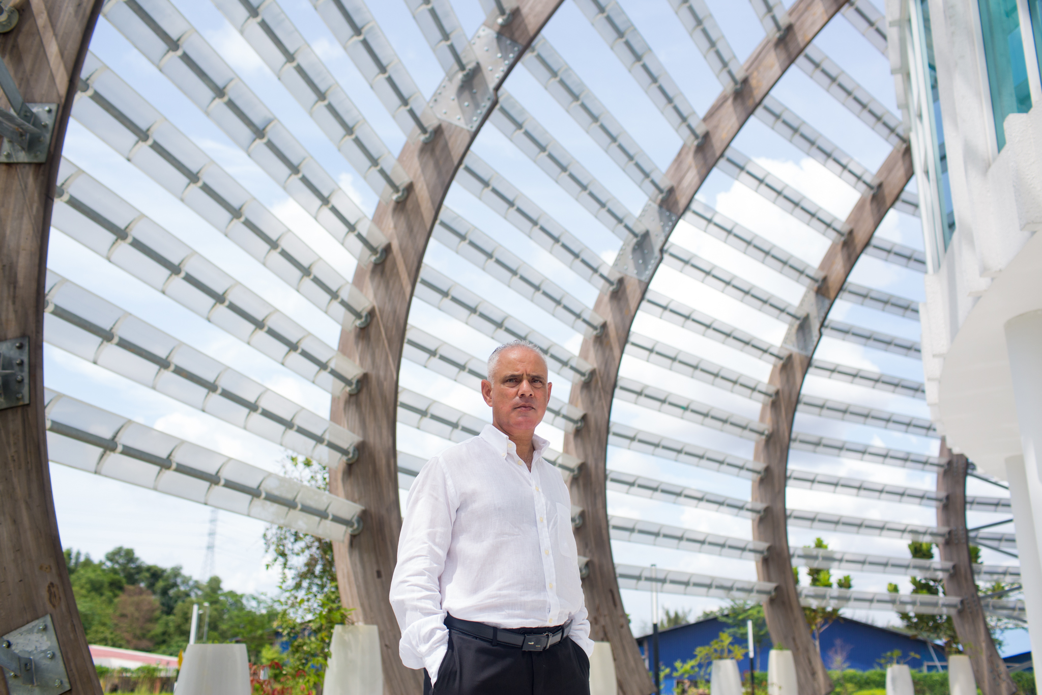 Sayed Azam-Ali, director of Crops for the Future, stands inside one of the domes that house the research institute. The energy-efficient structures, Azam-Ali says, embody the sustainable future of agriculture.