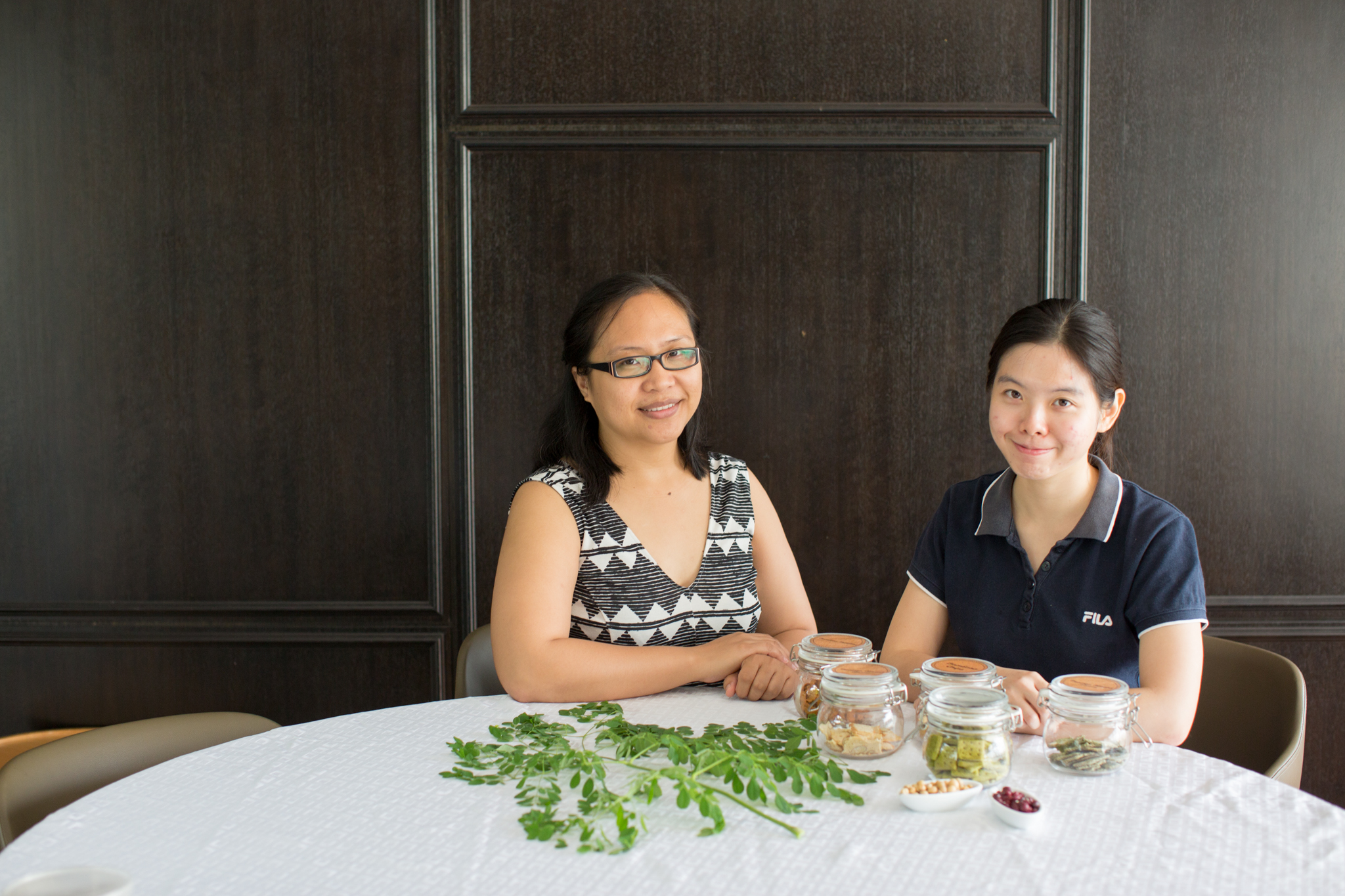 Food technologist Tan Xin Lin and FoodPLUS program manager Advina Julkifle discuss a variety of products developed at Crops for the Future.