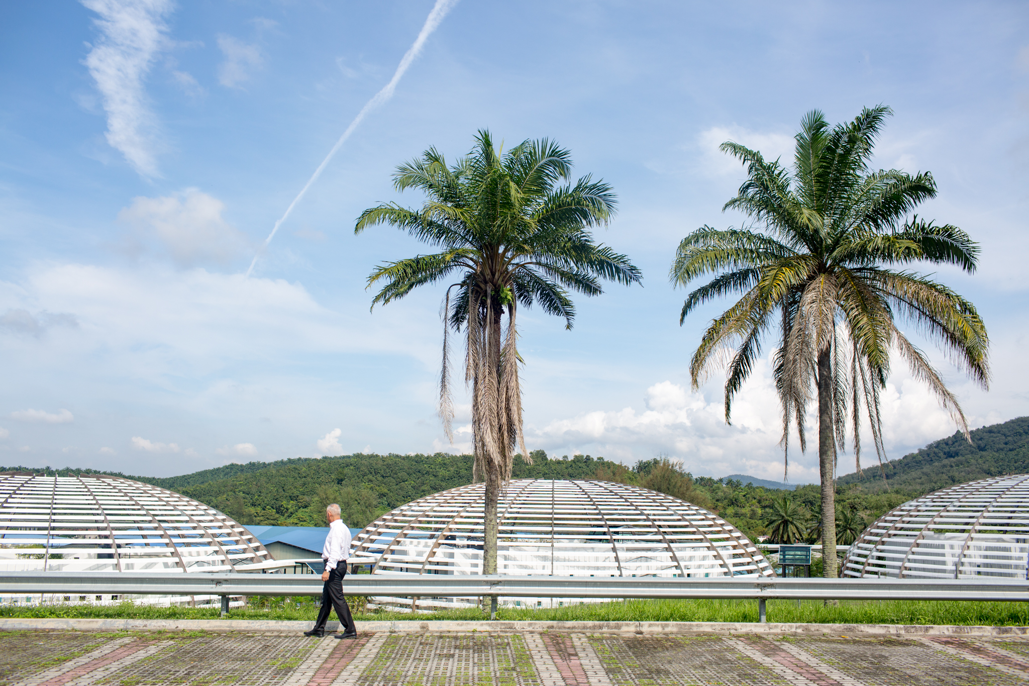 Sayed Azam-Ali, director of Crops for the Future, strolls past the domes that house the institute on the campus of the University of Nottingham in Semenyih, Malaysia.