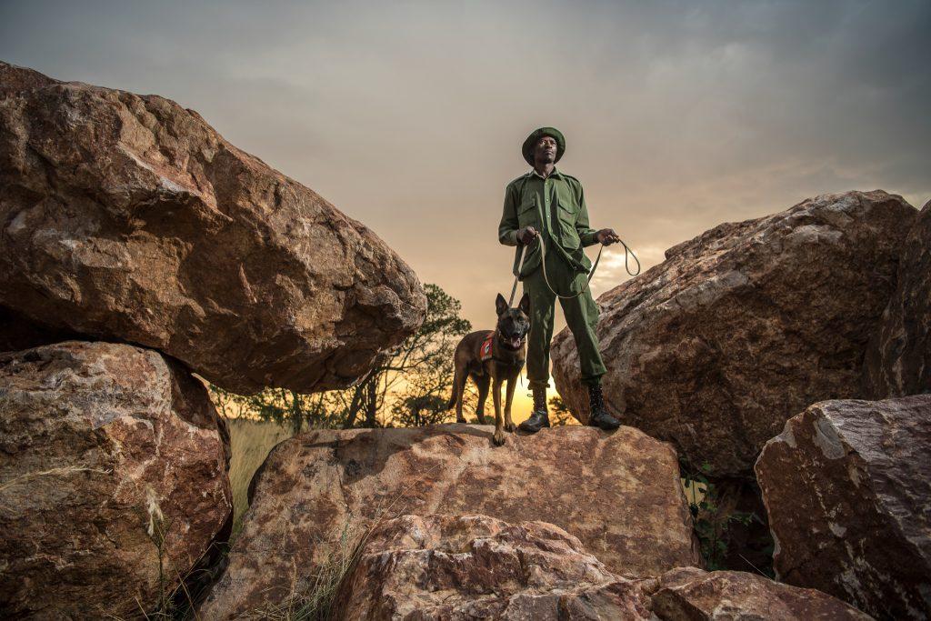 Sareta Be Peter stands with DJ at the Singita Grumeti Fund Reserves, a conservatory adjacent to Serengeti National Park in Tanzania.