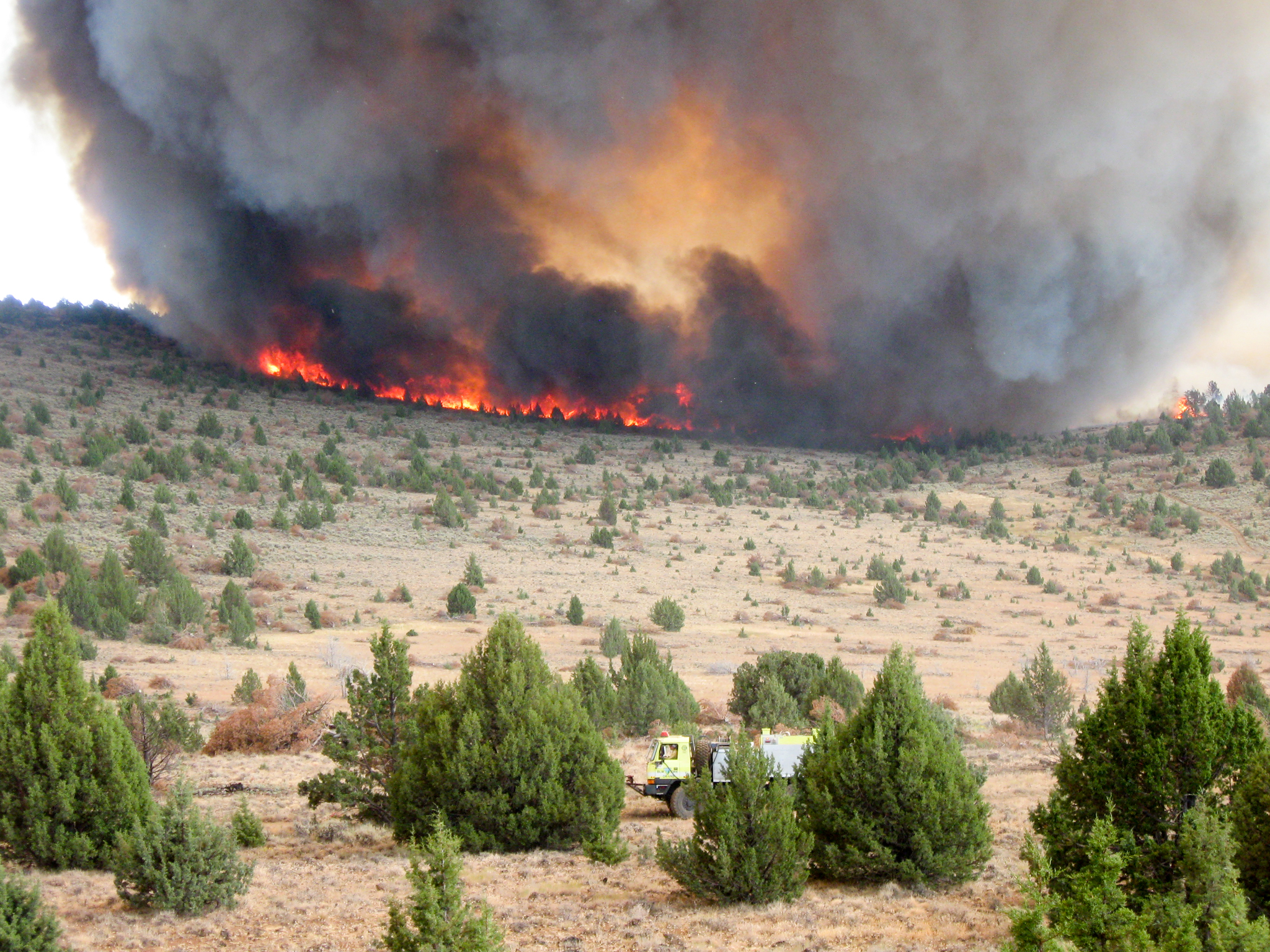 Bureau of Land Management crews monitor a controlled burn intended to restore the sagebrush steppe ecosystem in the Five Creeks area of eastern Oregon. Photograph by Travis Miller