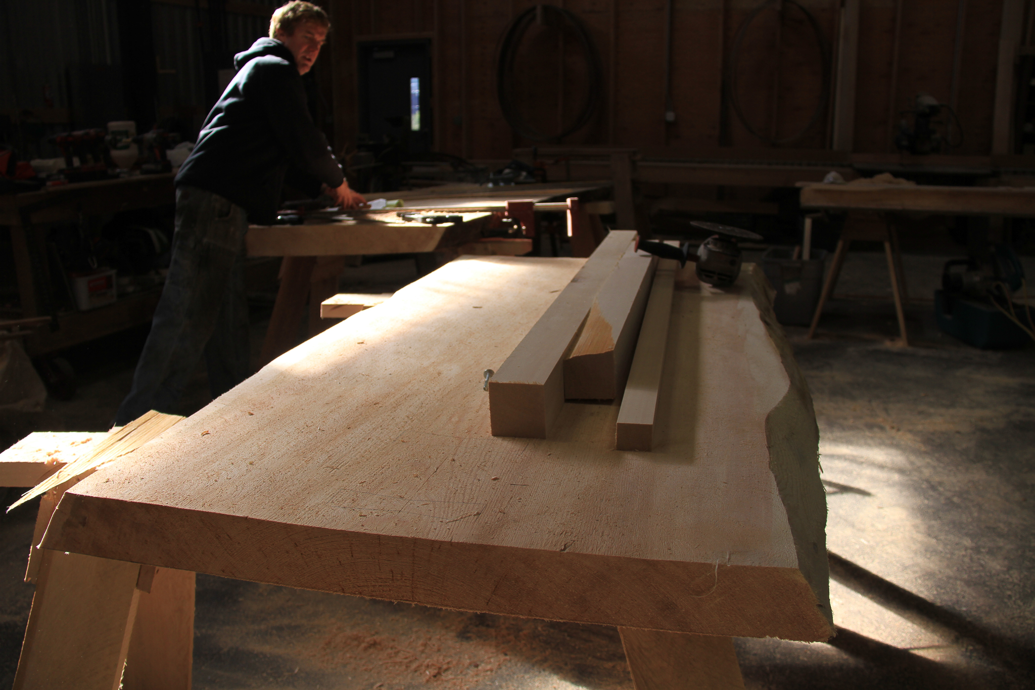 Like many of the small mills in Southeast Alaska, Larry Jackson's Tongass Forest Enterprises in Ketchikan makes value-added products out of old-growth trees. Here, Jackson shows some slab tables that will fill a custom order from a local family.