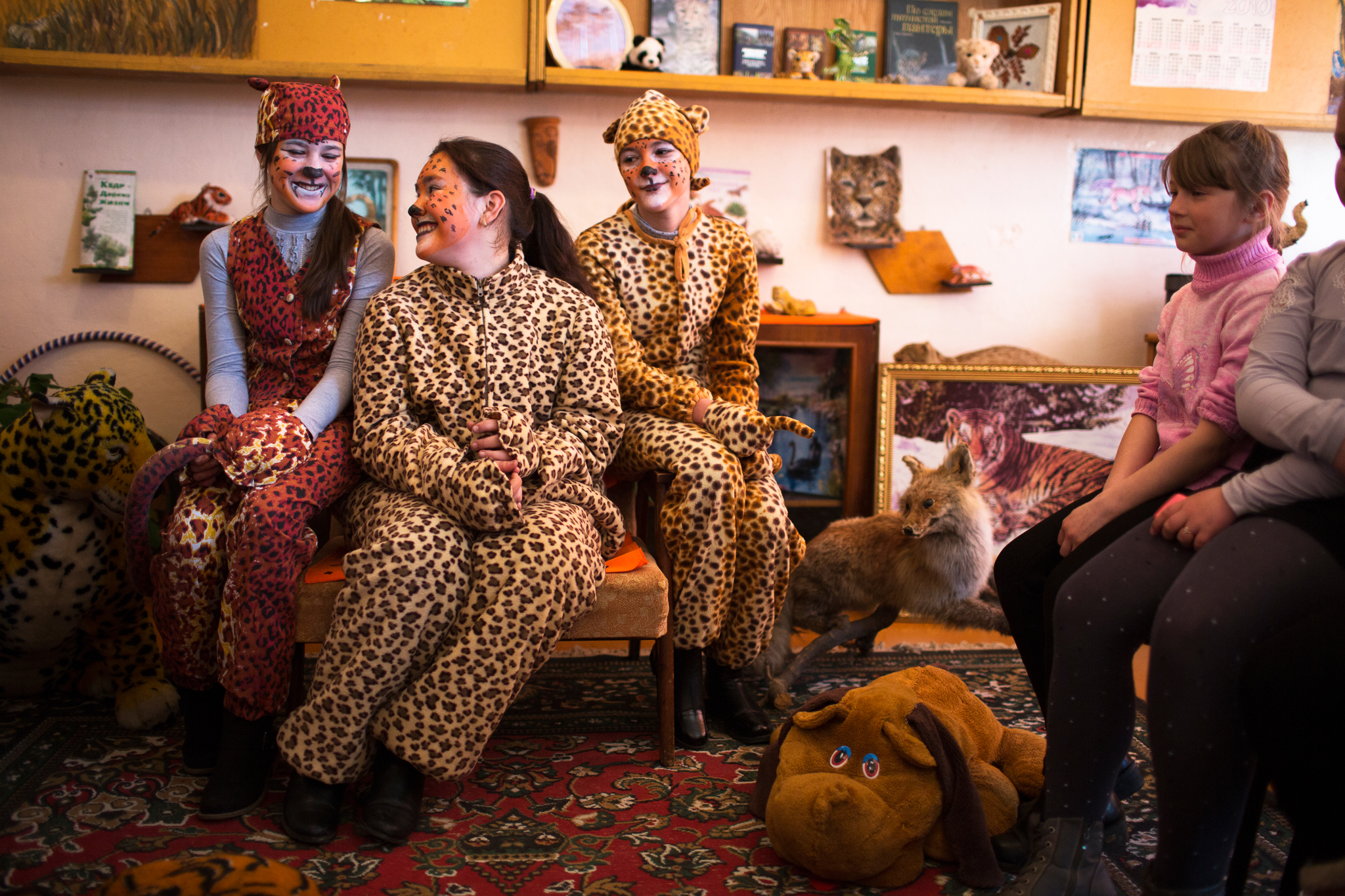 In Slavyanka, just outside the border of Land of the Leopard National Park, high school students Anya Blednova (front left) and two of her friends dress up as leopards once a month and visit grade schools to teach the younger children about the magnificent cats that live nearby.
