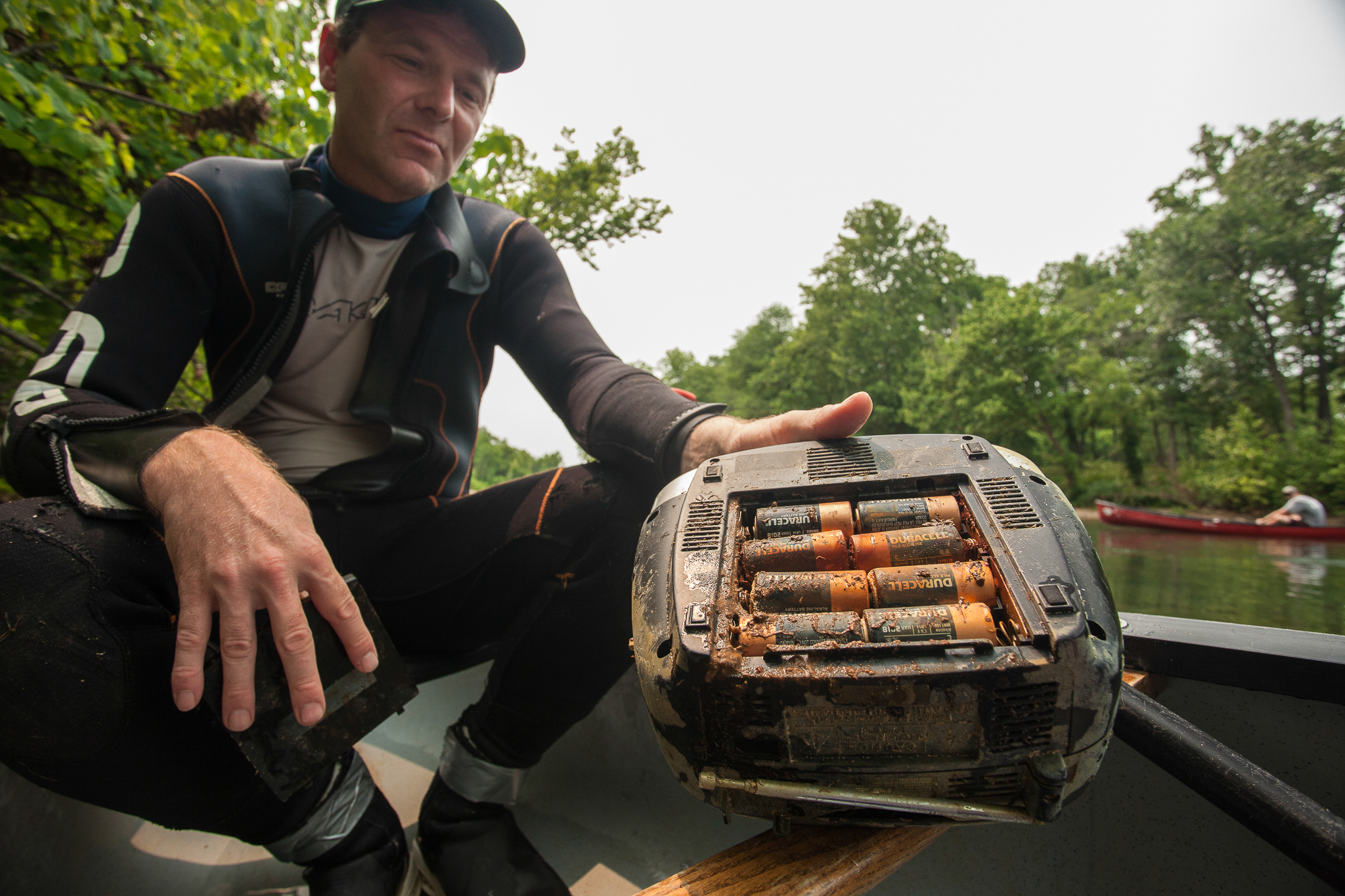 Water pollution is one of the many threats to Ozark hellbenders. Herpetologist Jeff Briggler with the Missouri Department of Conservation holds up one of the culprits—a discarded radio filled with corroded, leaking batteries.