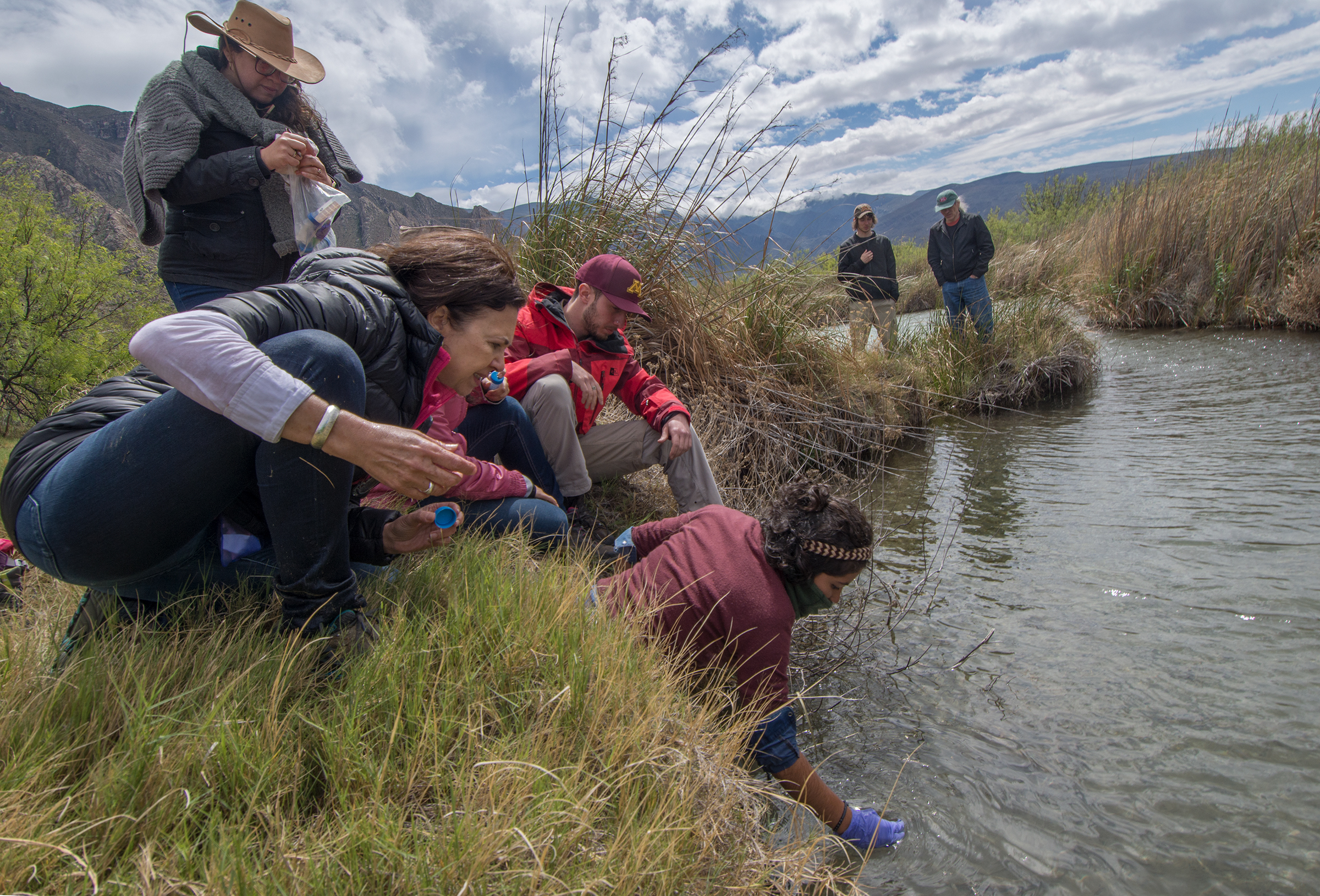 Researchers take water and sediment samples from what remains of the Churince river.