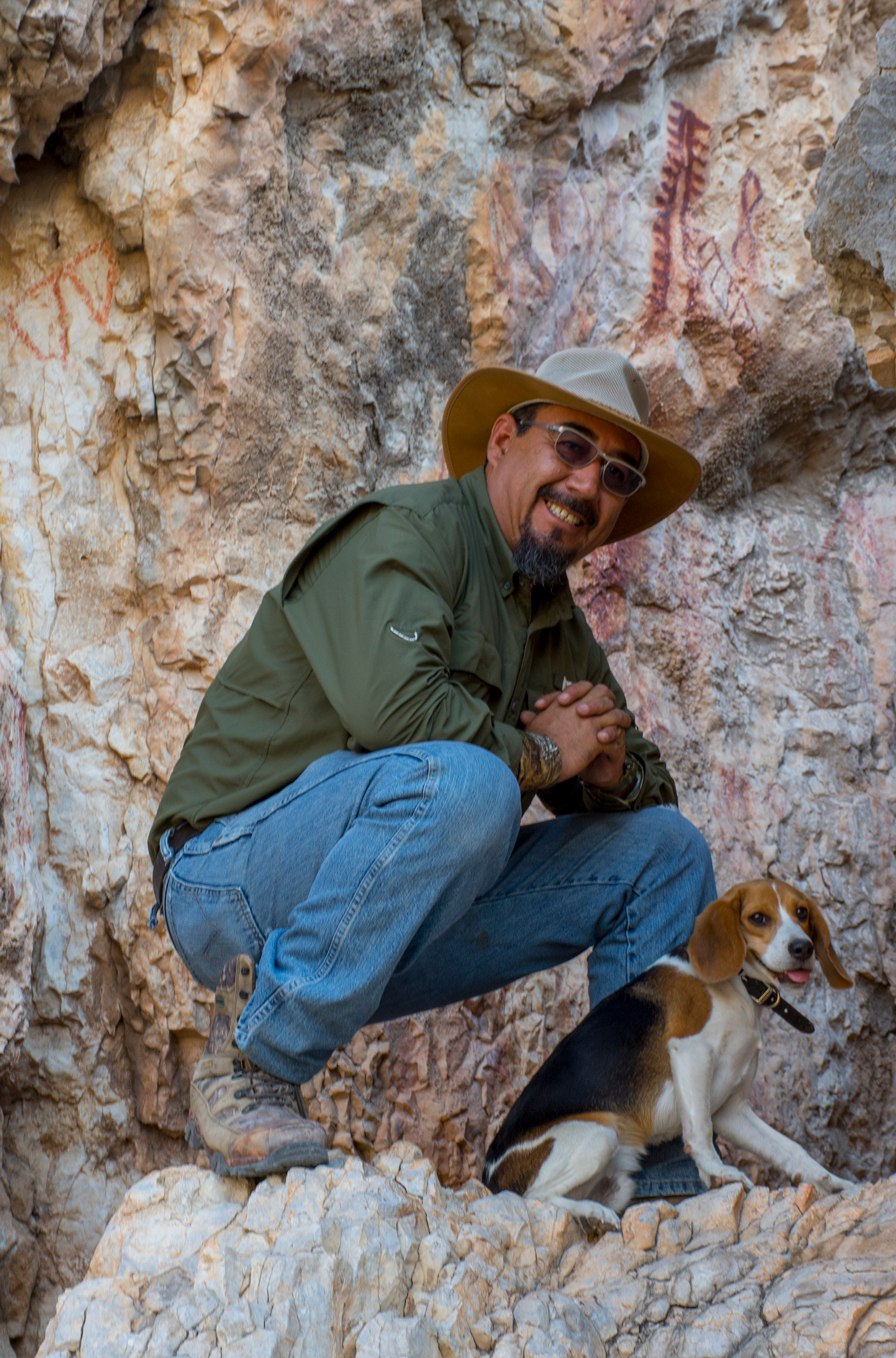 Archaeologist Turi de la Rosa and his dog Darwin pose in front of one of the many archaeological sites in Cuatro Ciénegas—some of which are threatened by environmental degradation.
