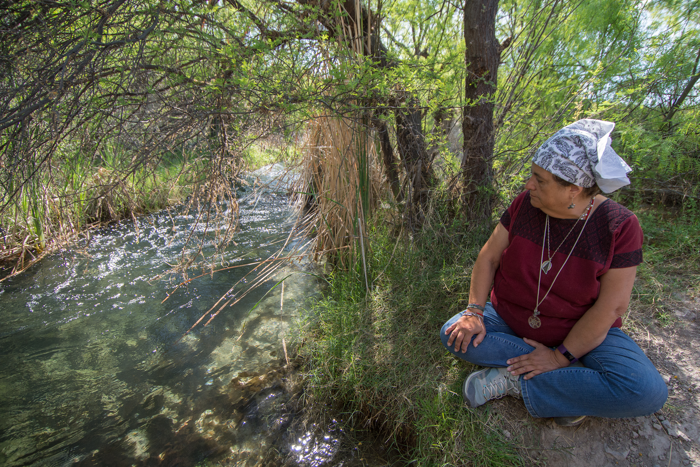 Valeria Souza gazes woefully at the Saca Salada irrigation canal that has been pulling water out of the basin since it was built in the early 1970s. Thanks to Souza's and other activists' efforts, the canal was recently closed.