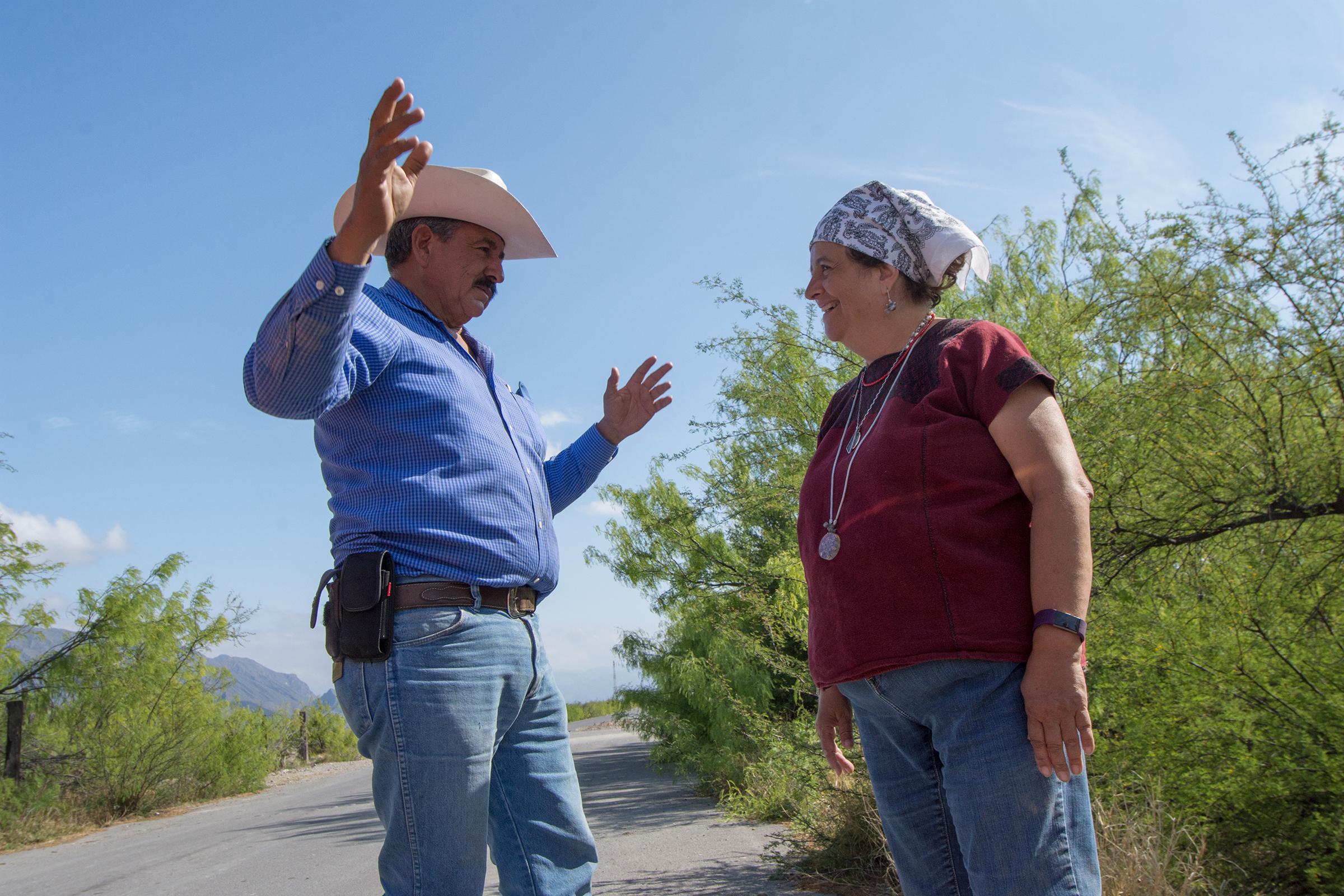 Local landowner Arturo Lerma and Valeria Souza discuss the importance of preserving the wetlands in the basin.