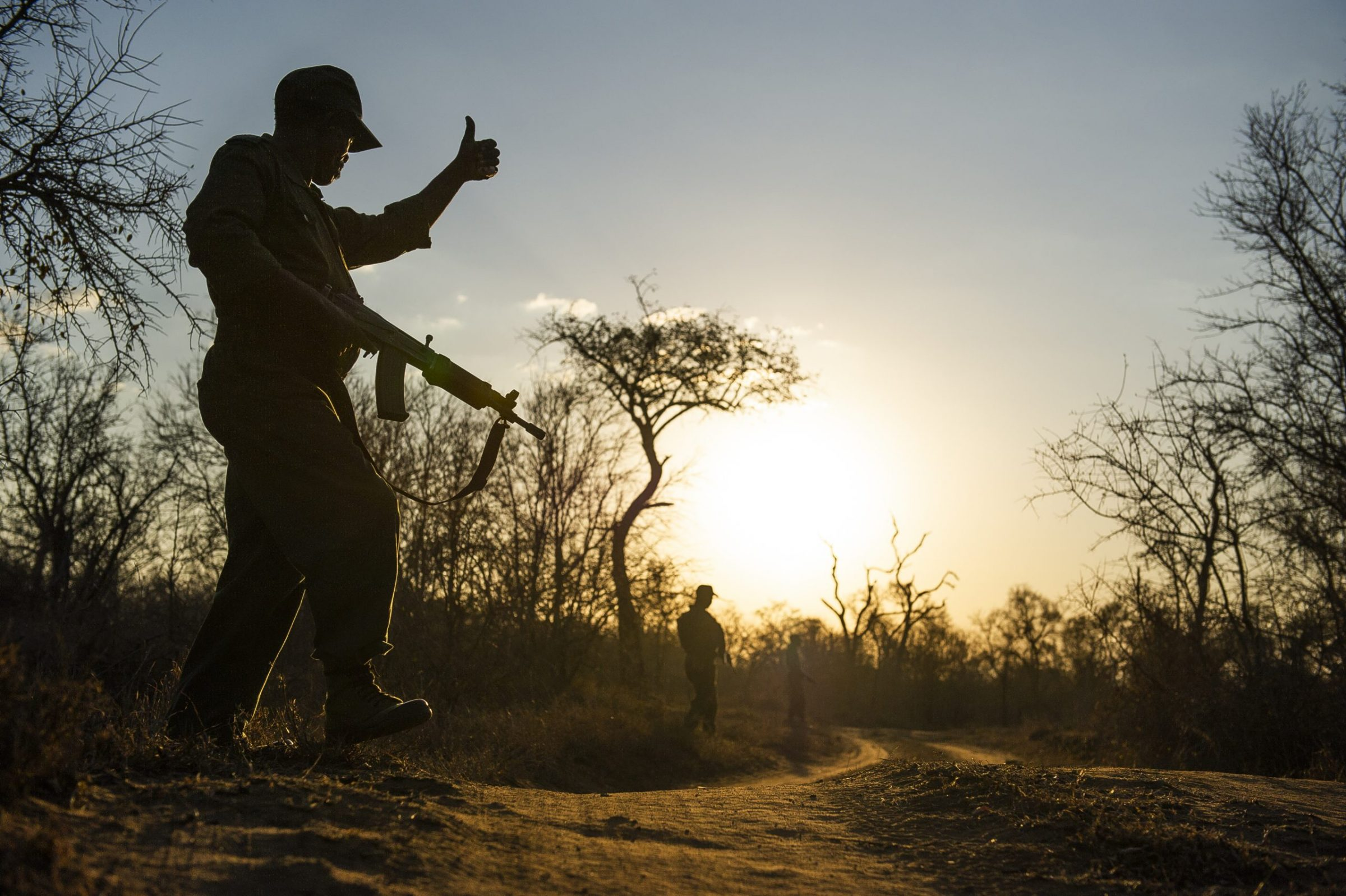 Rangers patrol an area in search of rhino poachers in Hlane Royal National Park, Swaziland.